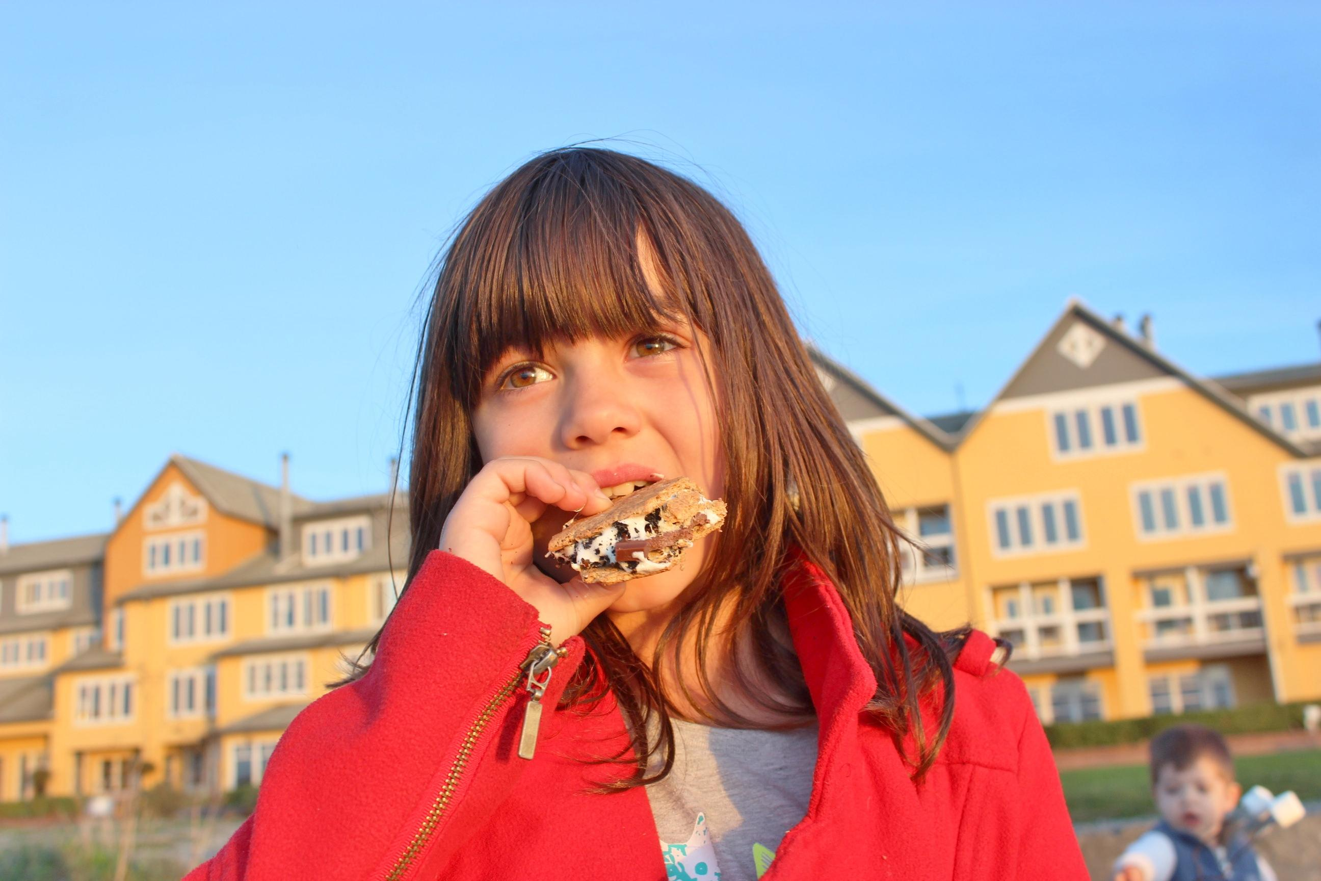 A young guest enjoying a s'more.<p></p>