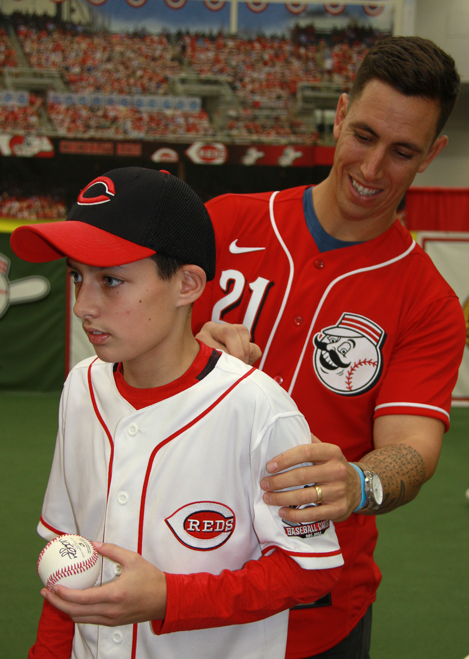 Michael Lorenzen, pitcher #21, signs a fan's shirt