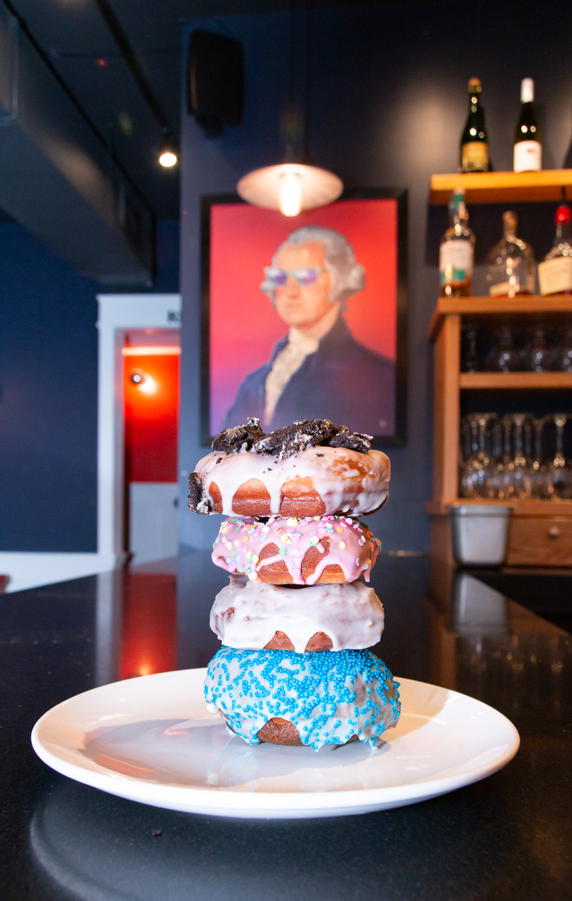 Doughnut tower featuring (from the top) Oreo, pink vanilla frosted with sprinkles, vanilla frosted, and Milkman—blue sprinkles filled with vanilla mousse / Image: Elizabeth A. Lowry // Published: 10.6.20