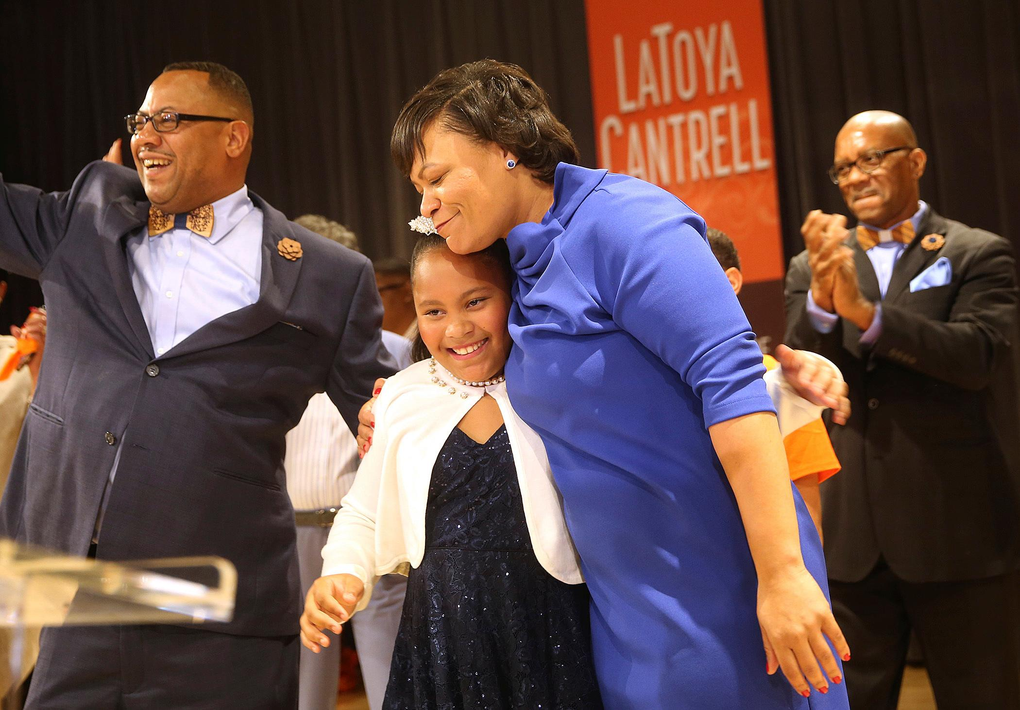 LaToya Cantrell hugs her daughter RayAnn as she celebrates her victory in the New Orleans mayoral election during her election party at the New Orleans Jazz Market in Central City, Saturday, Nov. 18, 2017, in New Orleans. Cantrell, a City Council member who gained a political following as she worked to help her hard-hit neighborhood recover from Hurricane Katrina, was the victor Saturday night in an election that will make her the first woman mayor in New Orleans' history. (Michael DeMocker/NOLA.com The Times-Picayune via AP)
