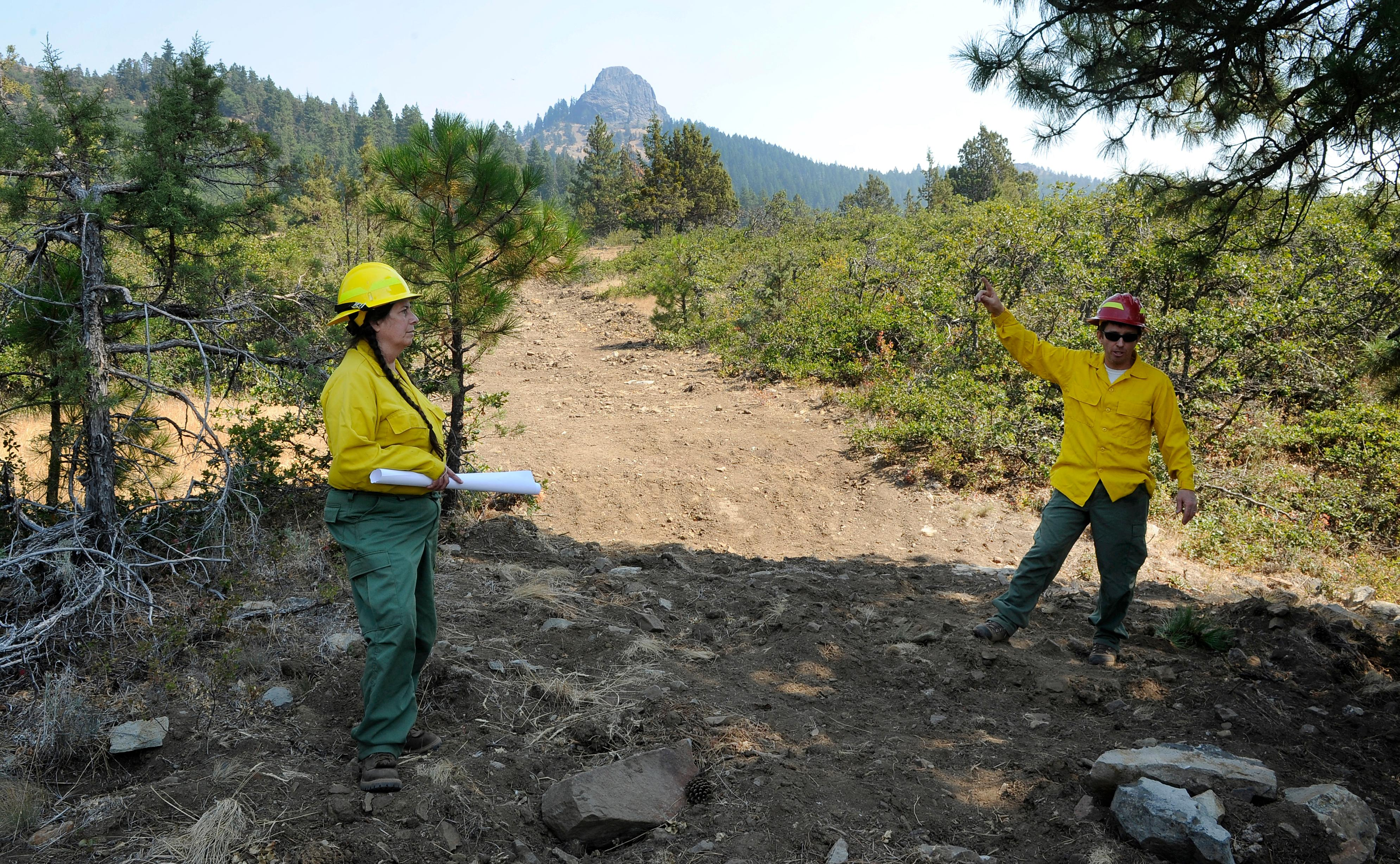 Andy Atkinson / Mail TribuneBLM hydrologist Tim Montfort talks with Mastrofini about the need for proper rehabilitation in the Soda Mountain Wilderness after the dozer work during the Klamathon fire.