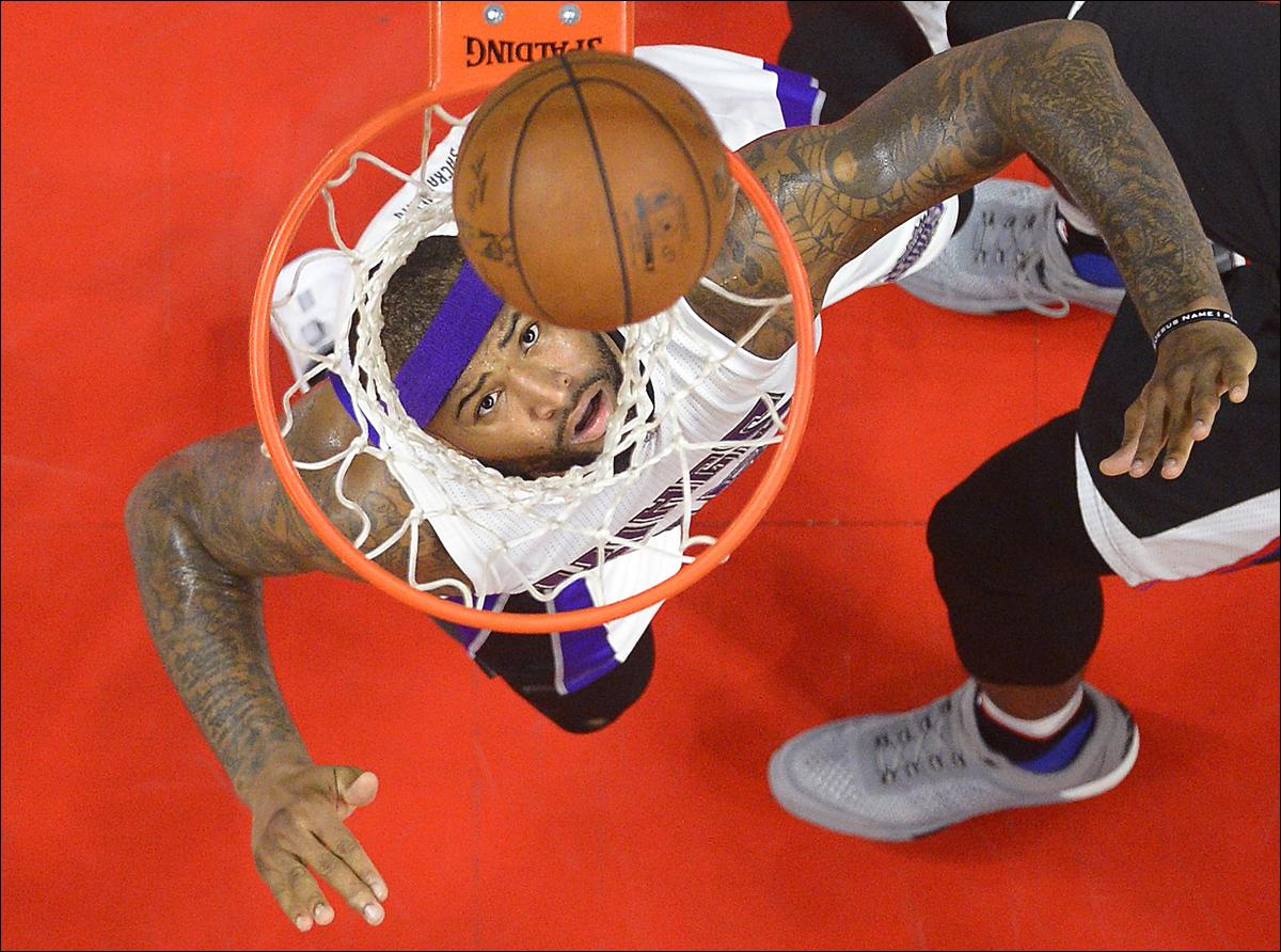 Sacramento Kings center DeMarcus Cousins watches a shot by ;the Los Angeles Clippers go in during the first half of an NBA basketball game, Saturday, Jan. 16, 2016, in Los Angeles. (AP Photo/Mark J. Terrill)