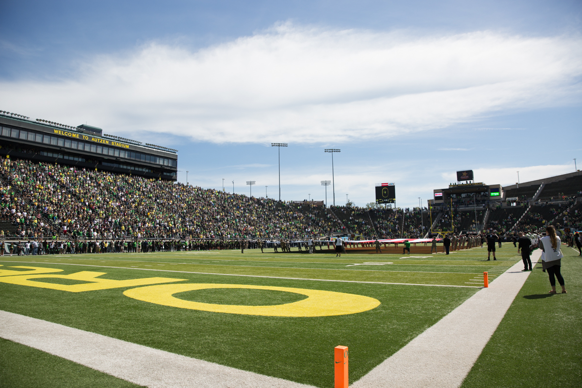 University of Oregon ROTC members hold the American flag during the singing of the national anthem. The 2017 Oregon Ducks Spring Game provided fans their first look at the team under new Head Coach Willie Taggart's direction.  Team Free defeated Team Brave 34-11 on a sunny day at Autzen Stadium in Eugene, Oregon.  Photo by Austin Hicks, Oregon News Lab