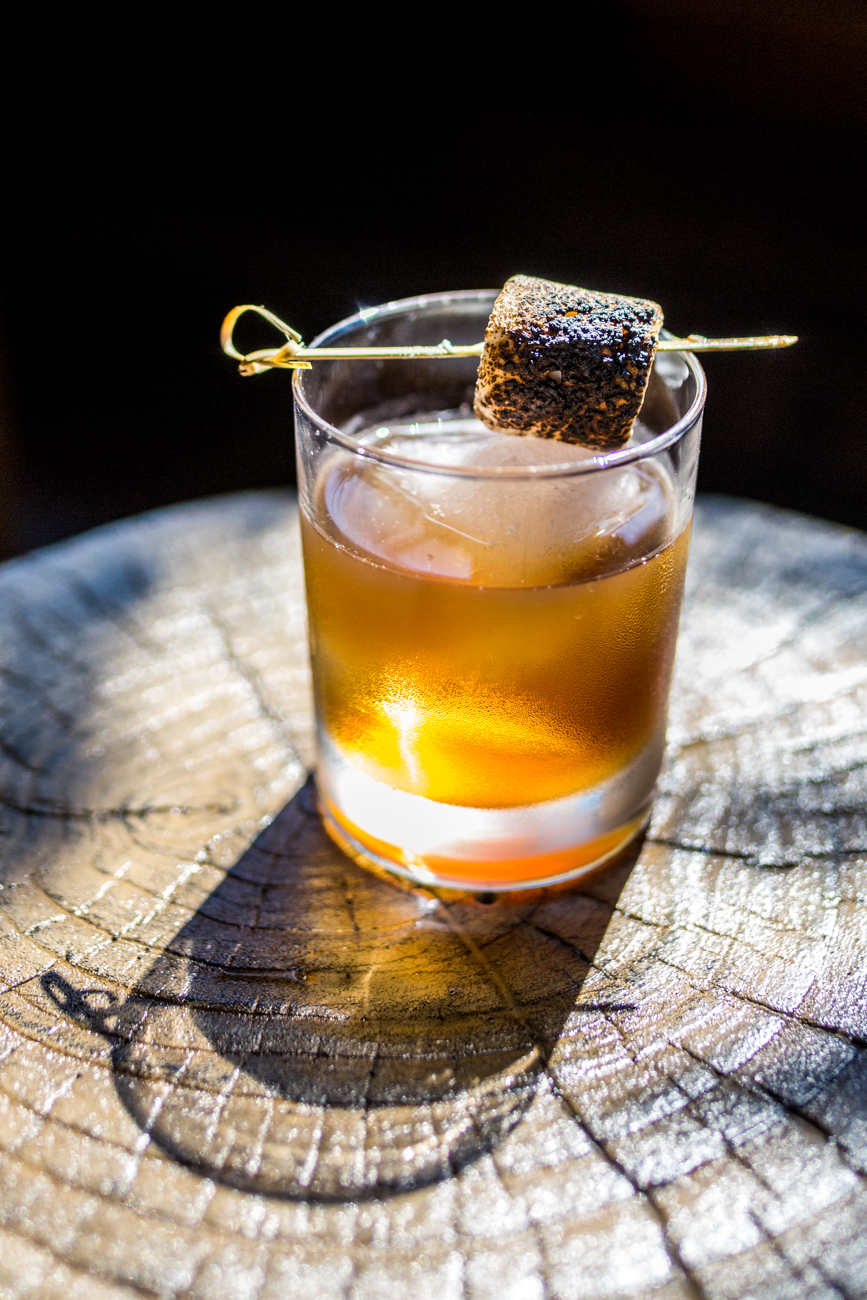Campfire Breakfast: bacon fat washed bourbon, smoked bitters, maple syrup, and burnt marshmallow / Image: Catherine Viox // Published: 7.18.19