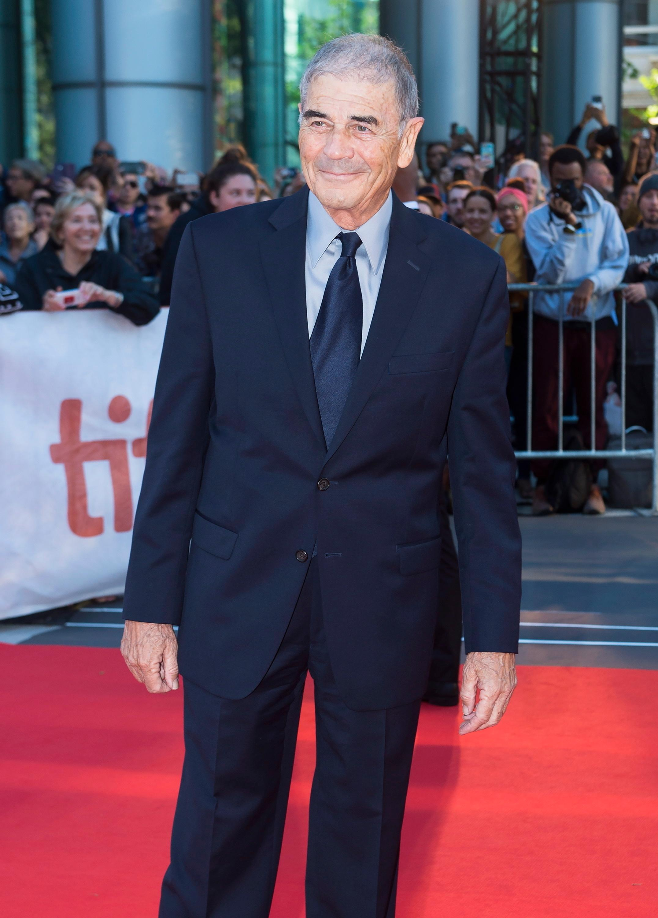 "FILE - In this Sept. 12, 2018 file photo, actor Robert Forster poses for photographs on the red carpet for the new movie ""What They Had"" during the 2018 Toronto International Film Festival in Toronto. Forster, the handsome character actor who got a career resurgence and Oscar-nomination for playing bail bondsman Max Cherry in ""Jackie Brown,"" has died at age 78. Forster's agent Julia Buchwald says he died Friday, Oct. 11, 2019, at home in Los Angeles of brain cancer. (Nathan Denette/The Canadian Press via AP, File)"