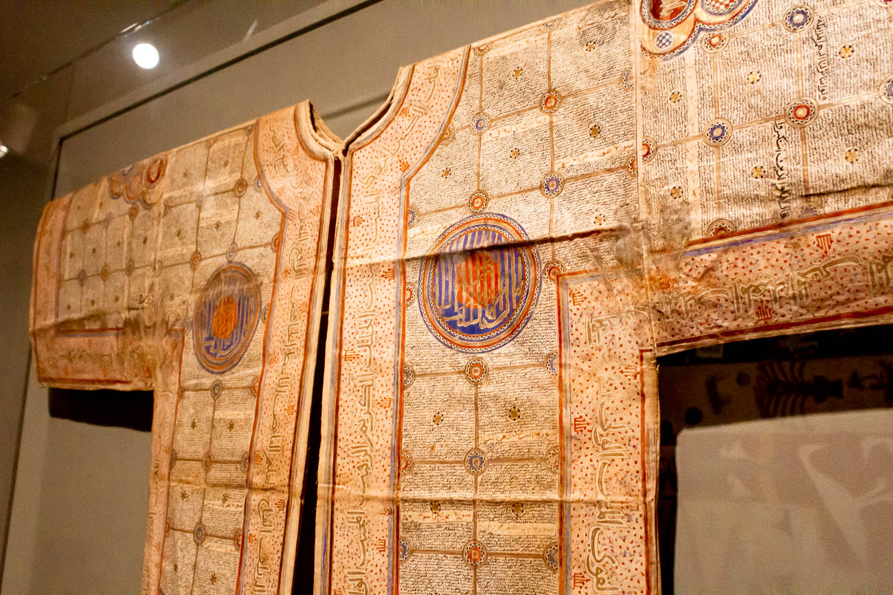 Talismanic shirt from 1480-1520 is made of starch cotton. It is inscribed with inked verses from the Qur'an. This was worn under battle garments, which is why you can still see sweat stains on this piece. / Image: Katie Robinson, Cincinnati Refined // Published: 10.22.18