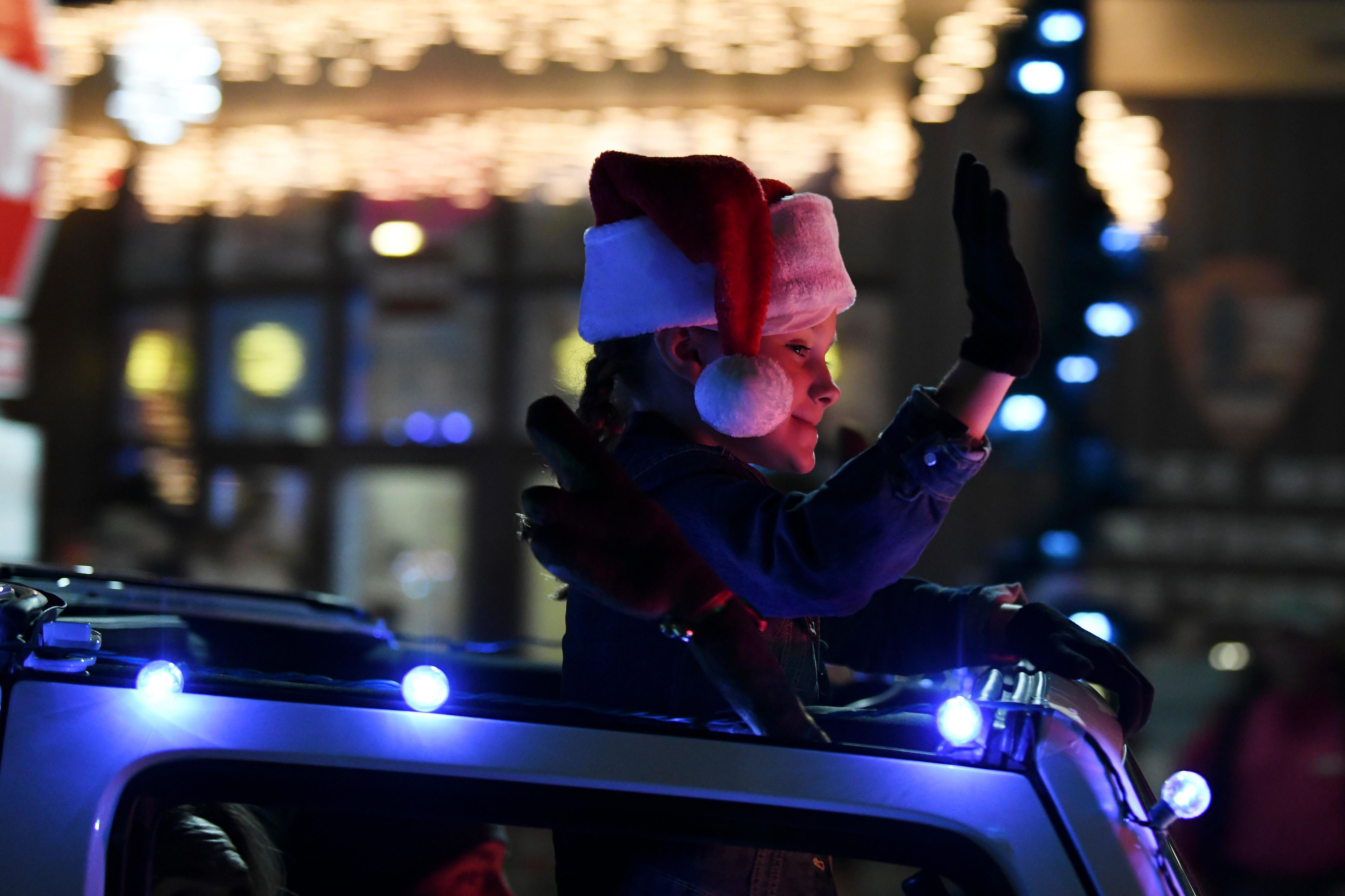 A young girl in a decorated vehicle waves to the crowd during the Santa's Electric Parade Saturday, December 2, 2017, in Boulder City. [Sam Morris/Las Vegas News Bureau]