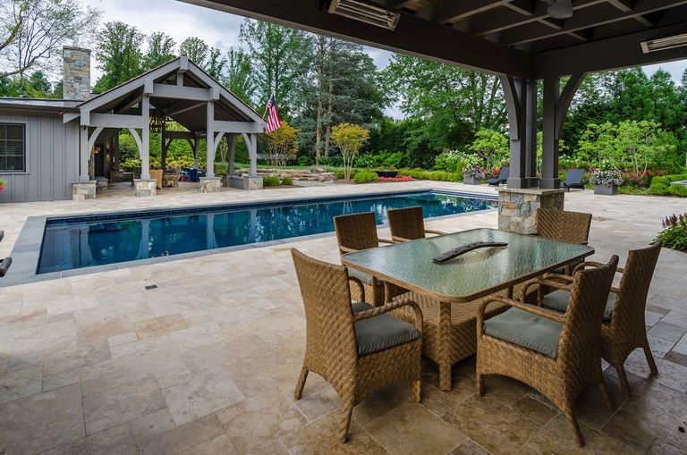Faneca invested $1 million in backyard design, including a sport spec pool, pool house with guest suite, outdoor kitchen and dining with Green Egg, heat lamps, fire pit and more.(Image: Courtesy HomeVisit)
