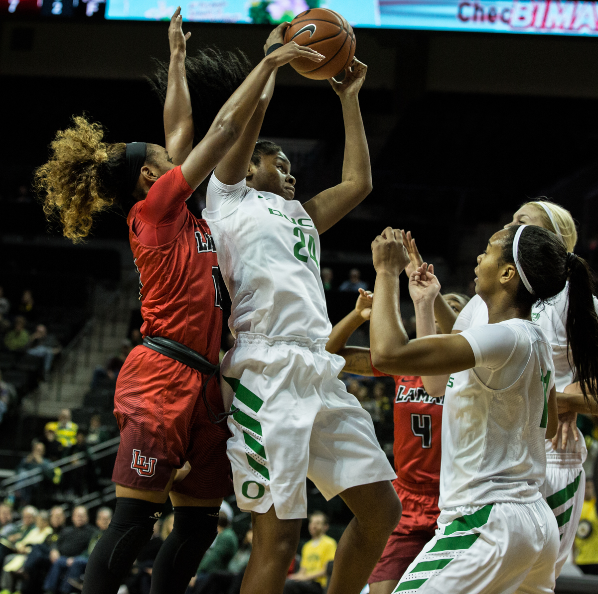 24 10Oregon Ducks forward Ruthy Hebard (#24) grabs the rebound in front of Cardinals guard Chastadie Barrs (#10). The Oregon Ducks Women's basketball team won their season opener against the Lamar Cardinals 84-67.  Photo by Austin Hicks, Oregon News Lab