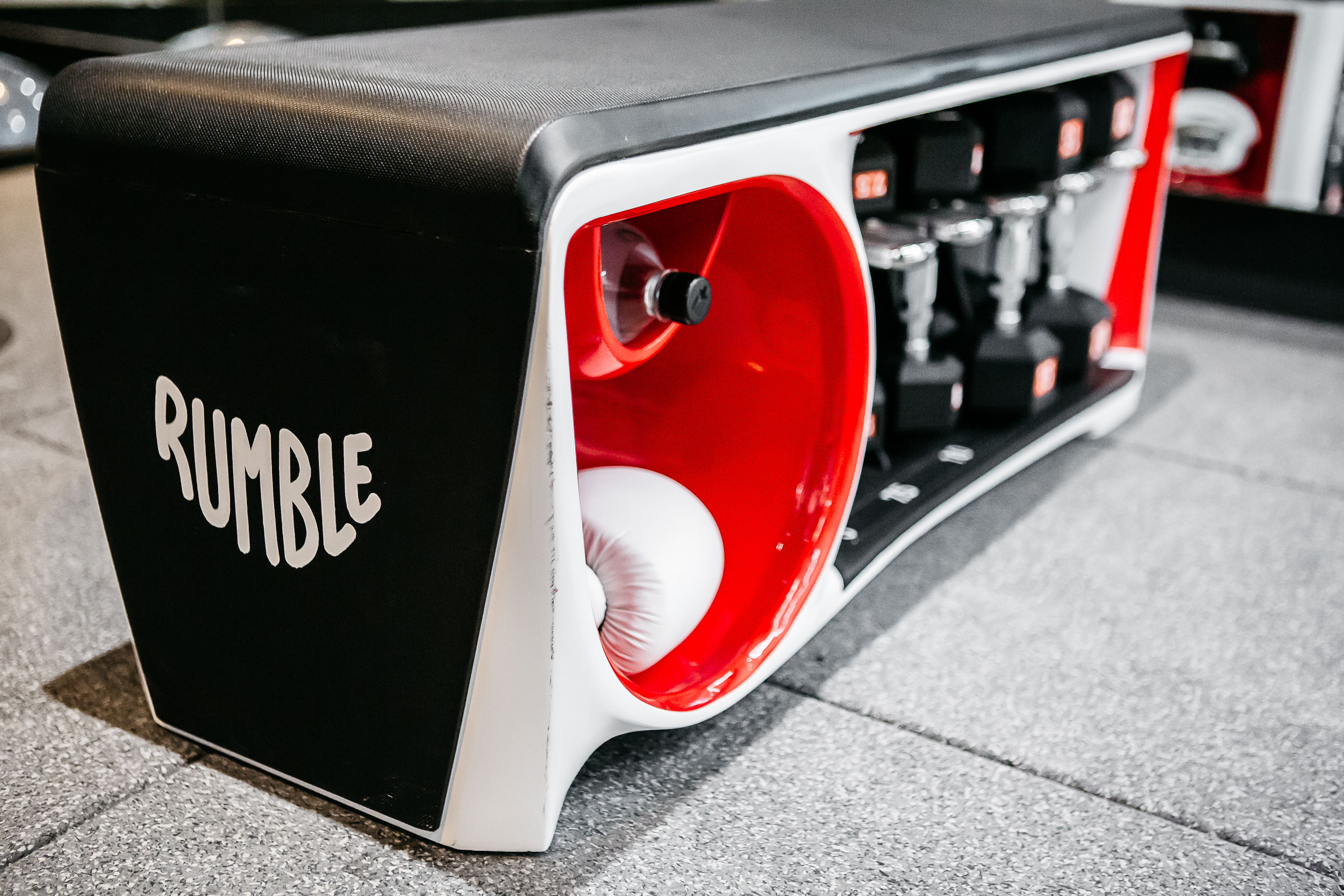 At the floor section, the benches have cubbies for easy glove and water bottle storage so you aren't tripping over people's stuff in the studio. (Image: Courtesy Rumble)