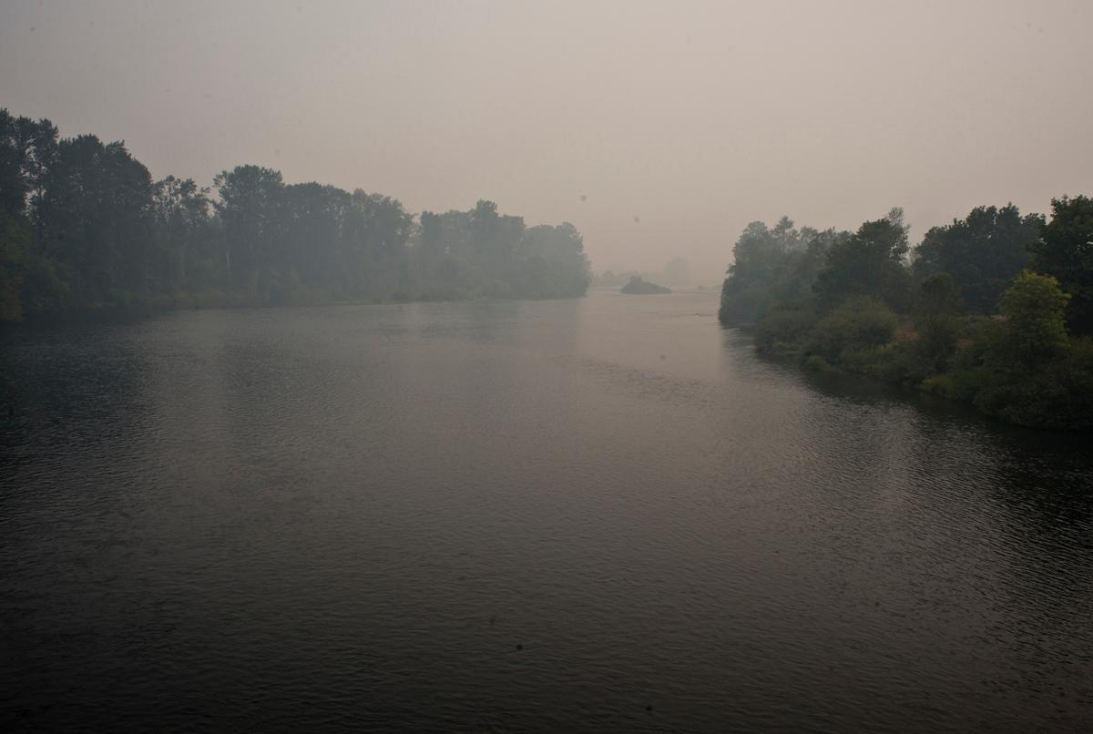 The Willamette River looking east from the Autzen footbridge at midday on Sunday. The smoke is from several nearby forest fires. Photo by Dan Morrison, Oregon News Lab