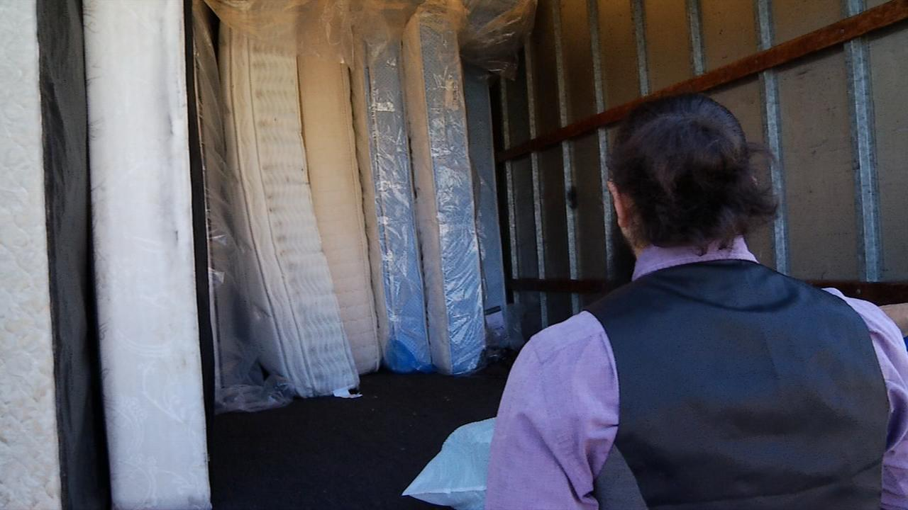 Chuck Emrick, the owner of Mattress Man, donates mattresses and box springs to Homeward Bound. (Photo credit: WLOS staff)