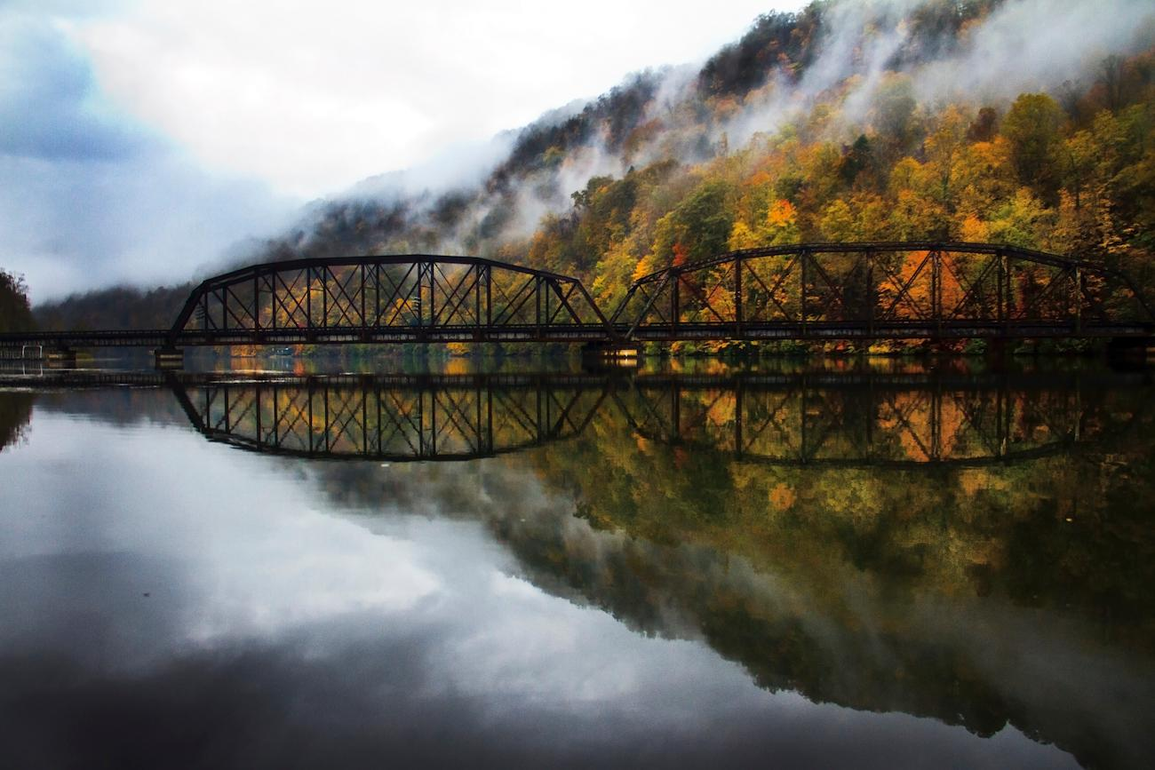 PLACE: New River in West Virginia / DISTANCE: 300 miles southeast of Cincinnati, a five-hour drive / Reflect on the stunning beauty of fall along West Virginia's New River. Adventures on the Gorge is a resort that's a great basecamp for your explorations with an array of accommodations, dining, hiking and mountain biking options, and viewpoints of the spectacular New River Gorge. / Image courtesy of Adventures on the Gorge // Published: 10.19.19