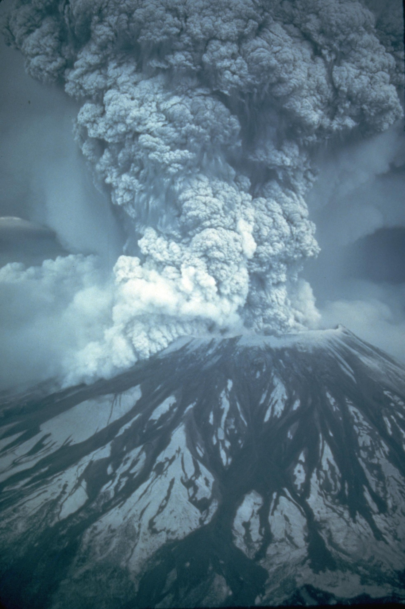 Mount St. Helens stood silent for over a century. Earthquakes swarmed the mountain in March 1980. Cracks appeared in the snow and ice atop the peak a few days later. And on March 27, the ash spewed from the top of the volcano.Geologists worked to study the peak as it rumbled back to life.What happened next caught the scientific community off guard.At 8:32 a.m. on May 18, 1980, a 5.1 earthquake shook the mountain.The mountain didn't erupt up; it erupted out to the side.The mountain went from 9,677 to 8,364 feet tall in an instant.All told, 57 people died or disappeared. (Austin Post/USGS)