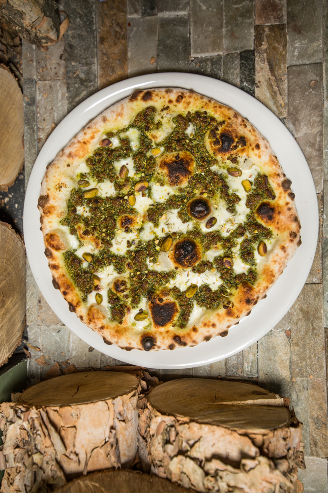 Pistachio pizza: pistachio pesto, fresh mozzarella, rosemary, parmigiano-reggiano, and extra virgin olive oil / Image: Catherine Viox{ }// Published: 6.17.19