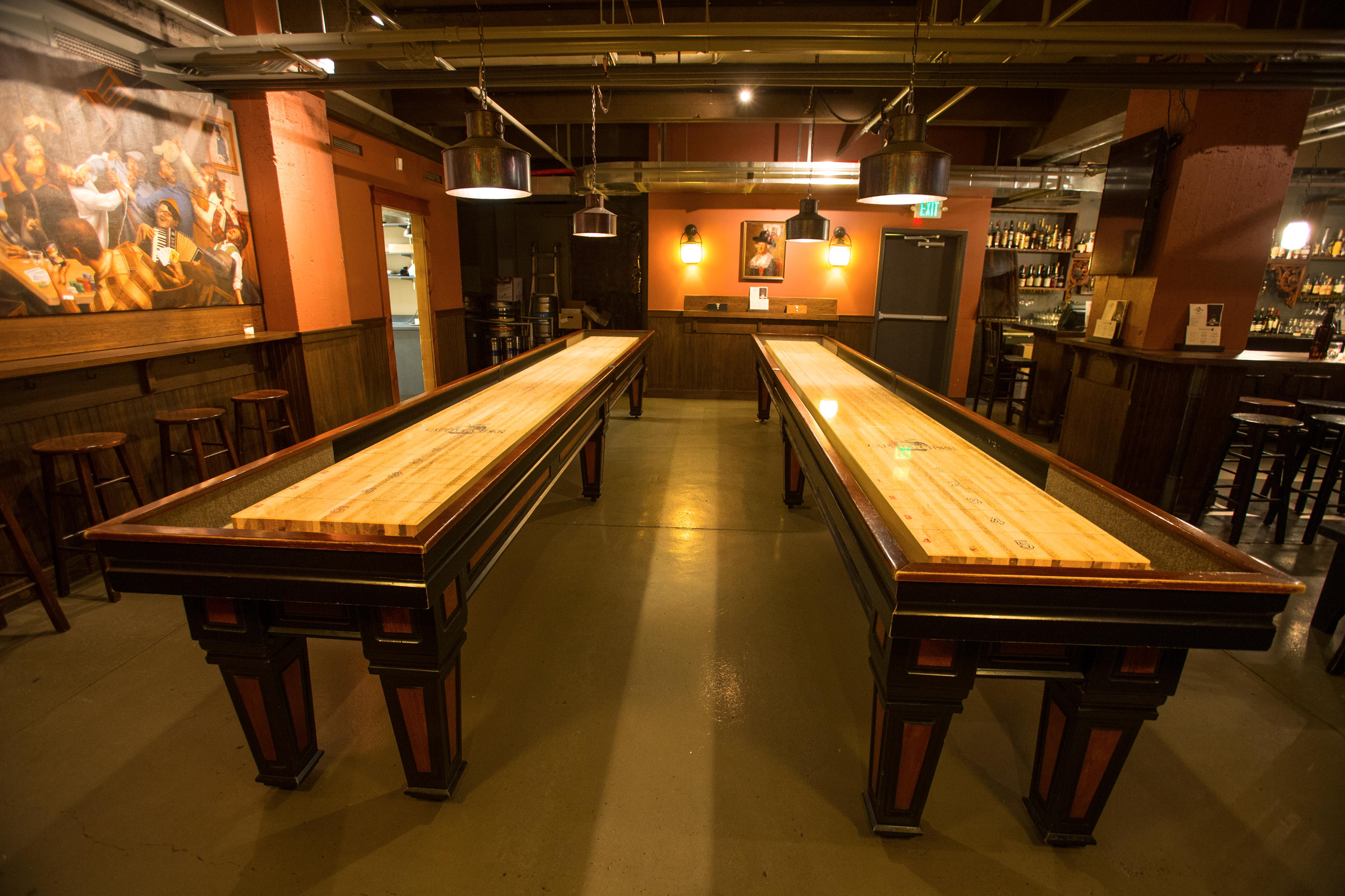 Capitol Cider's shuffleboard tables in their downstairs entertainment room. (Image: Capitol Cider)