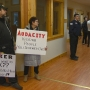 Demonstrators gather at Governor Walker's Menominee County listening session