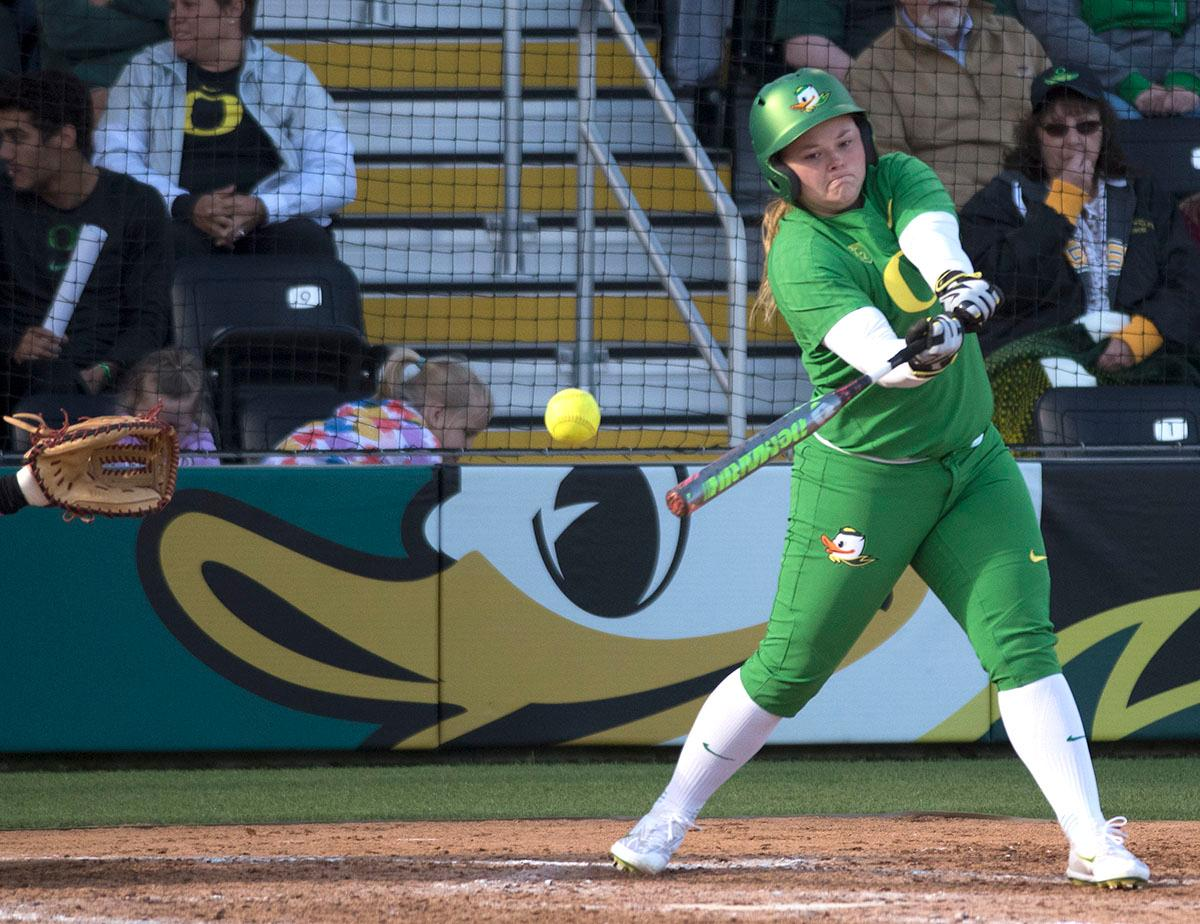 Oregon Ducks Madi Bishop (#23) swings for the ball. The No. 5 Oregon Ducks defeated the No. 2 Florida State Seminoles in both games of the doubleheader (11-0, 3-1) on Saturday afternoon. This sweep of the first two rounds of the postseason happened in front of a soldout crowd of 2,517 at Jane Sanders Stadium. Photo by Cheyenne Thorpe, Oregon News Lab