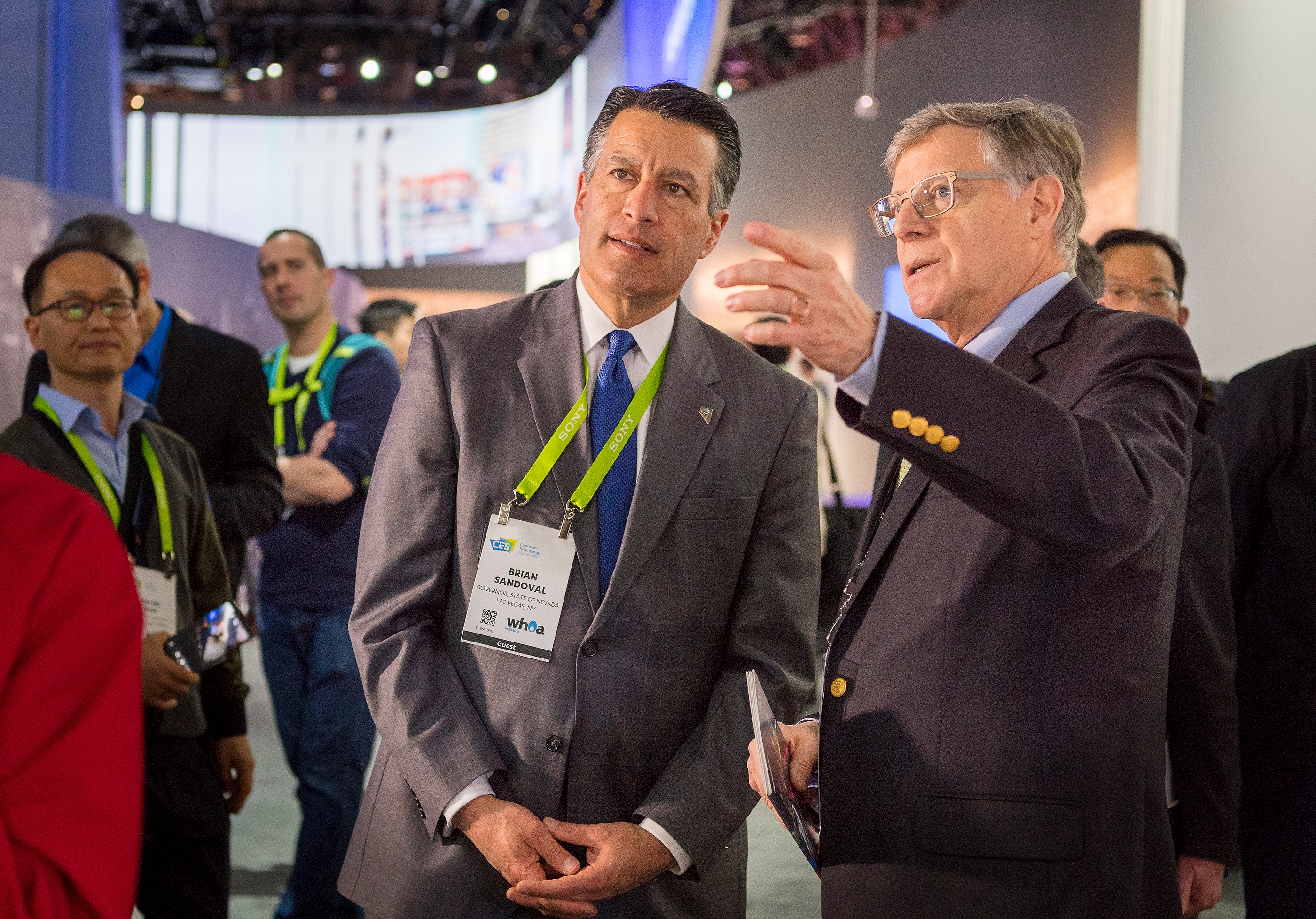 Nevada Governor Brian Sandoval, left, gets a tour of the Panasonic booth at CES by Peter Fannon, Vice President of Corporate, Government & Public Affairs, Panasonic Corporation of North America, Inc., at the Las Vegas Convention Center on Thursday, Jan. 11, 2018. CREDIT: Mark Damon/Las Vegas News Bureau