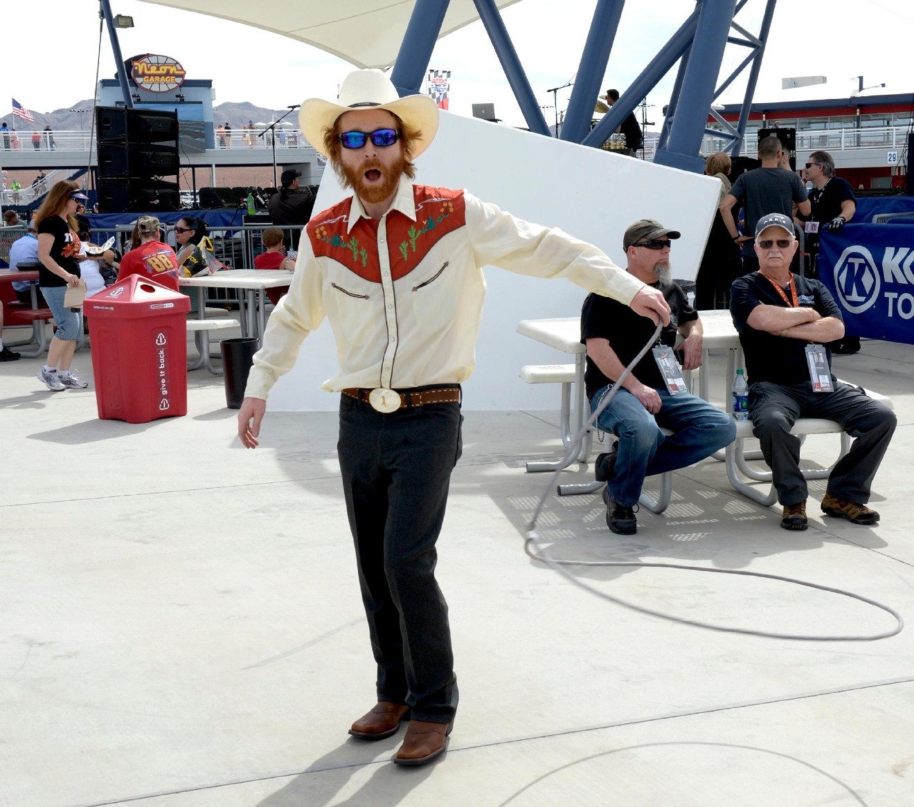 Fans are entertained with rope tricks as they enter the NEON Garage area during NASCAR Stratosphere Pole Day at Las Vegas Motor Speedway. Friday, March 10, 2017. (Glenn Pinkerton/Las Vegas News Bureau)