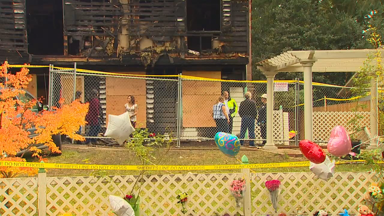 A memorial grows outside the home where two adults and two children were killed in a  fire near Port Orchard on Saturday, Oct. 14, 2017. (Photo: KOMO News)