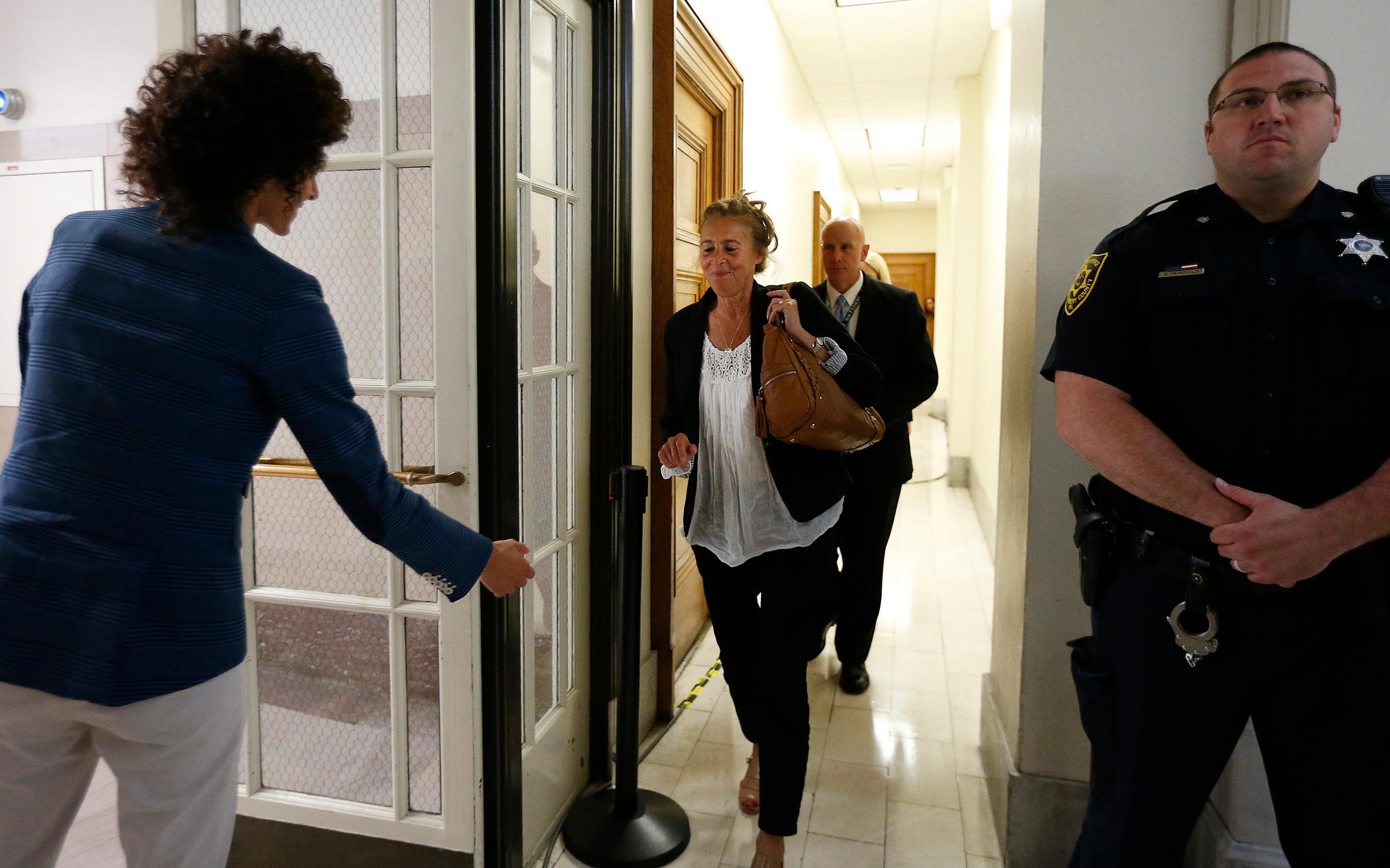 Andrea Constand, left, waits for her mother, Gianna Constand, center, outside the courtroom after closing arguments in Bill Cosby's sexual assault trial at the Montgomery County Courthouse in Norristown, Pa., Monday, June 12, 2017. Both women testified in the trial. (David Maialetti/The Philadelphia Inquirer via AP, Pool)