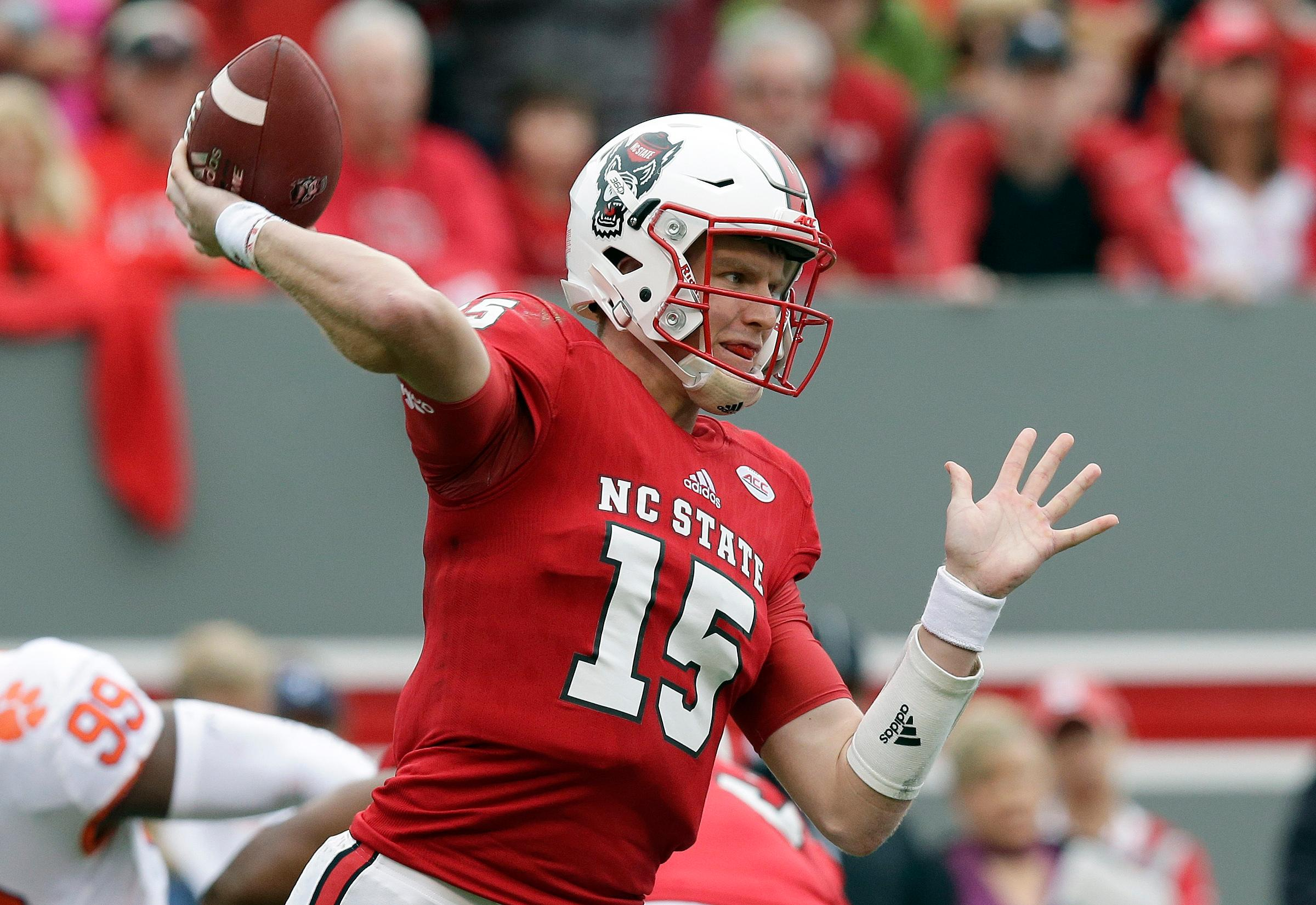 FILE - The Wolfpack (8-4) is seeking the second-most wins in school history, and trying to stay in the final College Football Playoff rankings. N.C. State was No. 24 going into bowl season. (AP Photo/Gerry Broome)