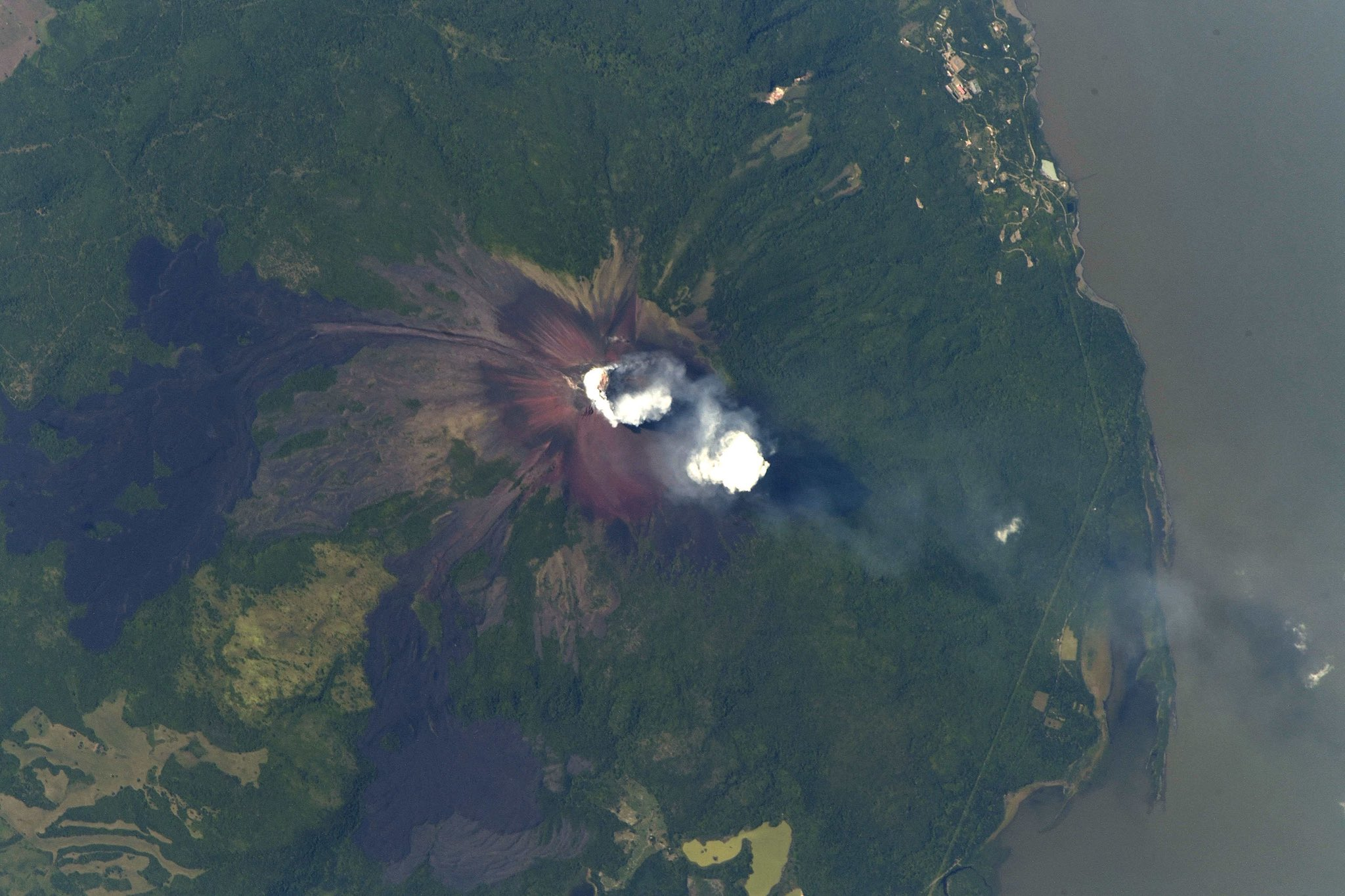 The violent beauty of our dynamic Earth revealed by a volcanic plume alongside Lake Atitl?n in #Guatemala. (Photo & Caption: Ricky Arnold / NASA)