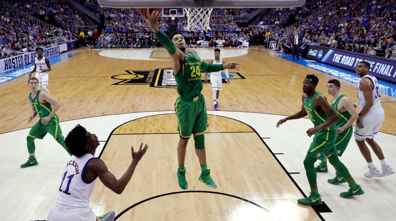 Oregon forward Dillon Brooks (24) grabs a rebound in front of Kansas guard Josh Jackson (11) during the first half of the Midwest Regional final of the NCAA men's college basketball tournament, Saturday, March 25, 2017, in Kansas City, Mo. (AP Photo/Charlie Riedel)