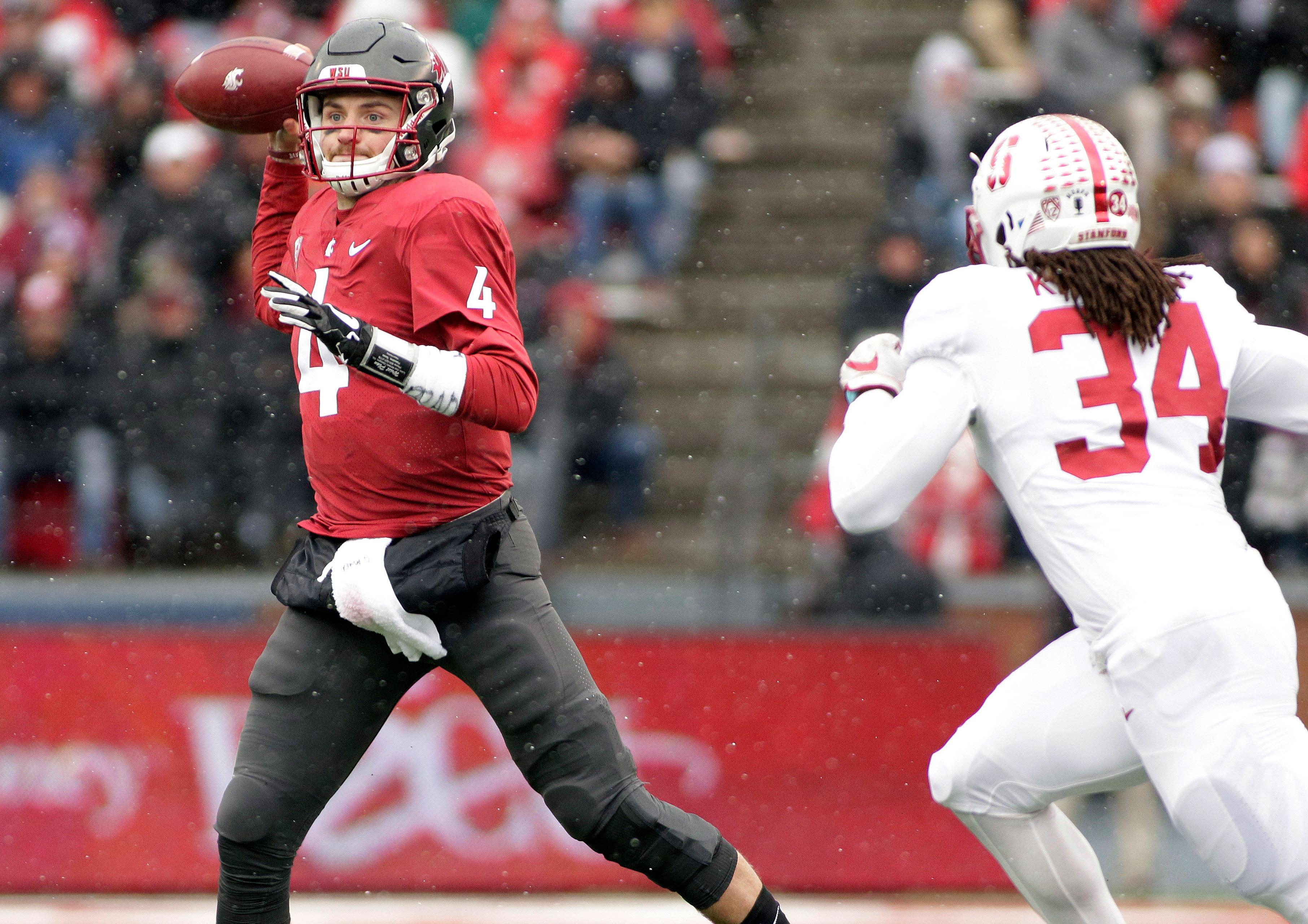 Washington State quarterback Luke Falk (4) throws a pass as he is chased by Stanford linebacker Peter Kalambayi (34) during the first half of an NCAA college football game in Pullman, Wash., Saturday, Nov. 4, 2017. (AP Photo/Young Kwak)
