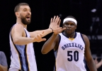 Memphis Grizzlies center Marc Gasol, left, and forward Zach Randolph (50) high five between plays in the first half of a game against the Milwaukee Bucks on Monday, March 13, 2017, in Memphis, Tenn.
