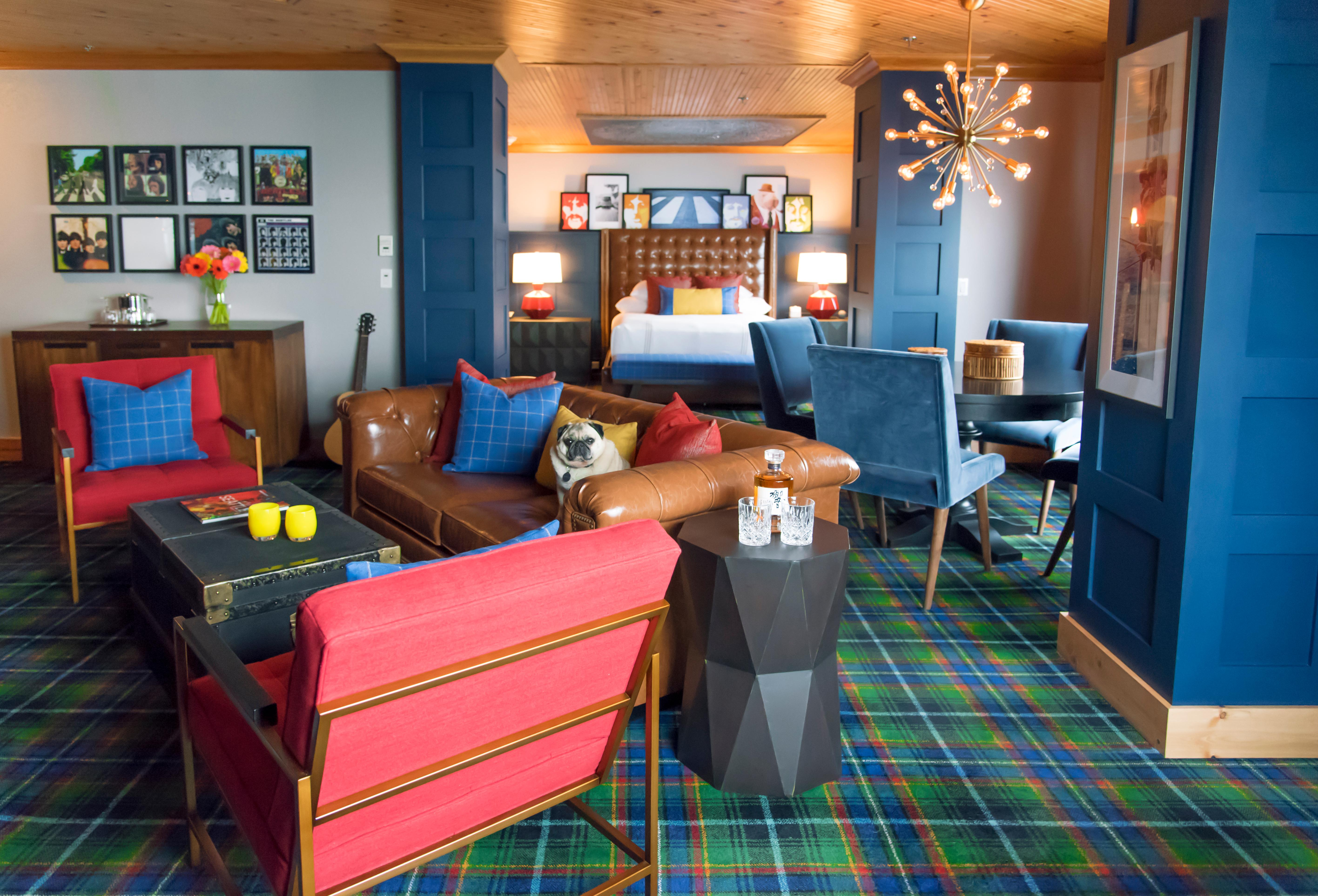 "The Beatles Suite.{ }Guests can stay in the very same room The Beatles once stayed in, where the iconic ""fishing out the window"" photo was captured of the band fishing out the window, in The Edgewater's famous Beatles Suite. The suite includes fascinating portraits, memorabilia, Beatles history and music. With contemporary elements of dark metals, white glass, leather, and designer lighting, this is the ultimate entertainment suite for music lovers. The iconic Beatles Suite, which has long been a tribute to the hotel's famed guests, received a design refresh in 2018, complete with new Beatles memorabilia, turntables, records, and much more for the ultimate fan to indulge in. (Image courtesy of Edgewater Hotel)"