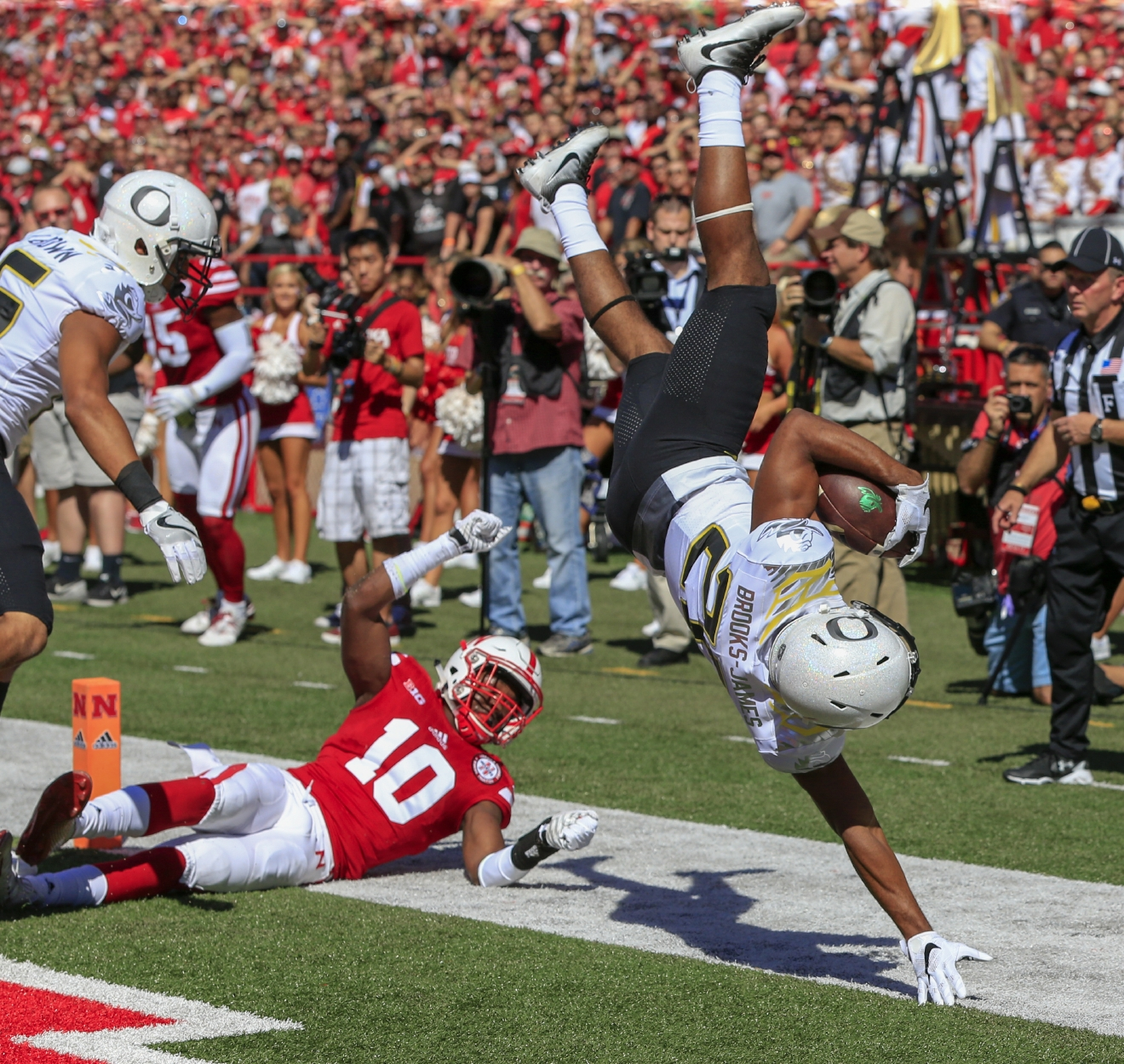 Oregon running back Tony Brooks-James (20) scores a touchdown over Nebraska cornerback Joshua Kalu (10) during the first half of an NCAA college football game in Lincoln, Neb., Saturday, Sept. 17, 2016. (AP Photo/Nati Harnik)