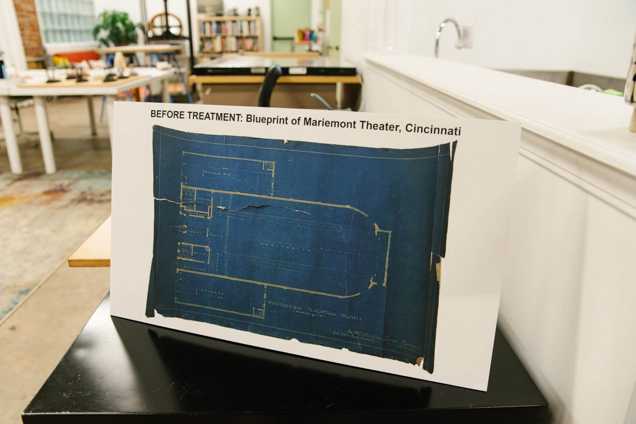 <p>A print of the original, damaged blueprint for the Mariemont Theatre has been recently improved and is now framed in the studio. / Image: Melissa Sliney{&nbsp;}// Published: 9.7.19</p>