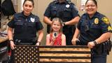 Little girl makes special flag for officers during police week