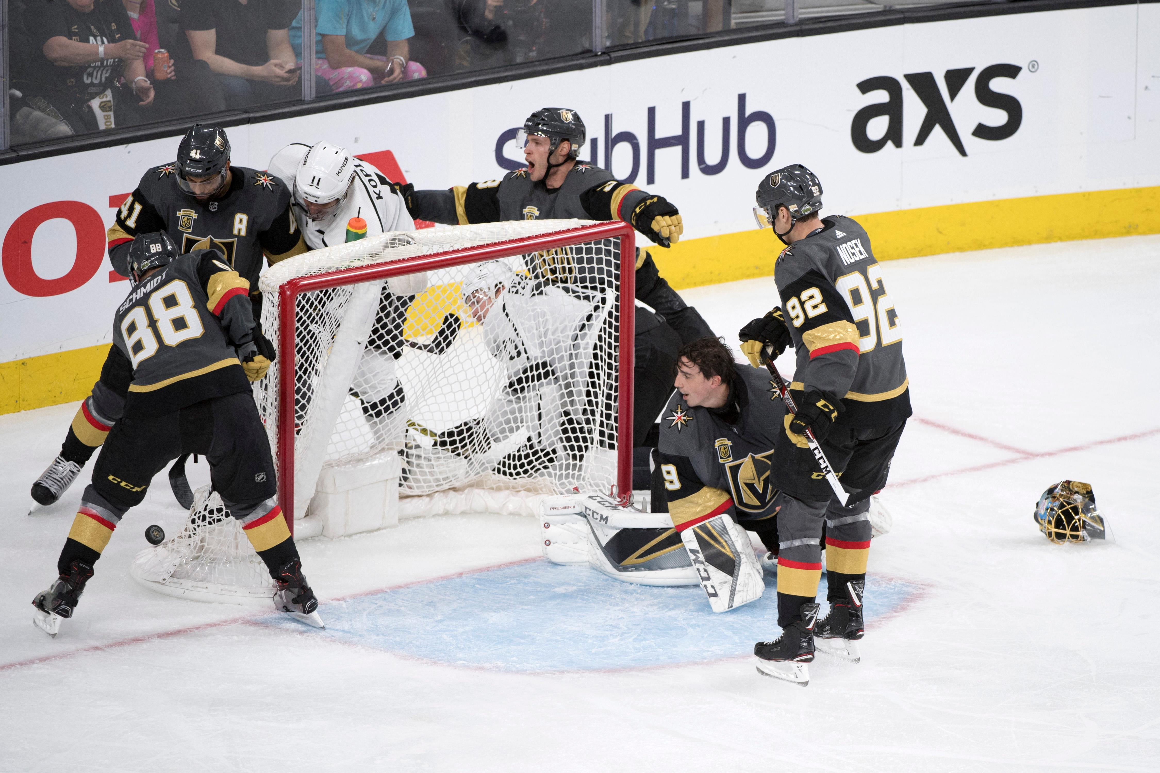 Vegas Golden Knights goaltender Marc-Andre Fleury (29) watches teammates try to clear the puck after losing his helmet during the third period of Game 1 of their NHL hockey first-round playoff series against the Los Angeles Kings Wednesday, April 11, 2018 at T-Mobile Arena. The Knights won 1-0. CREDIT: Sam Morris/Las Vegas News Bureau