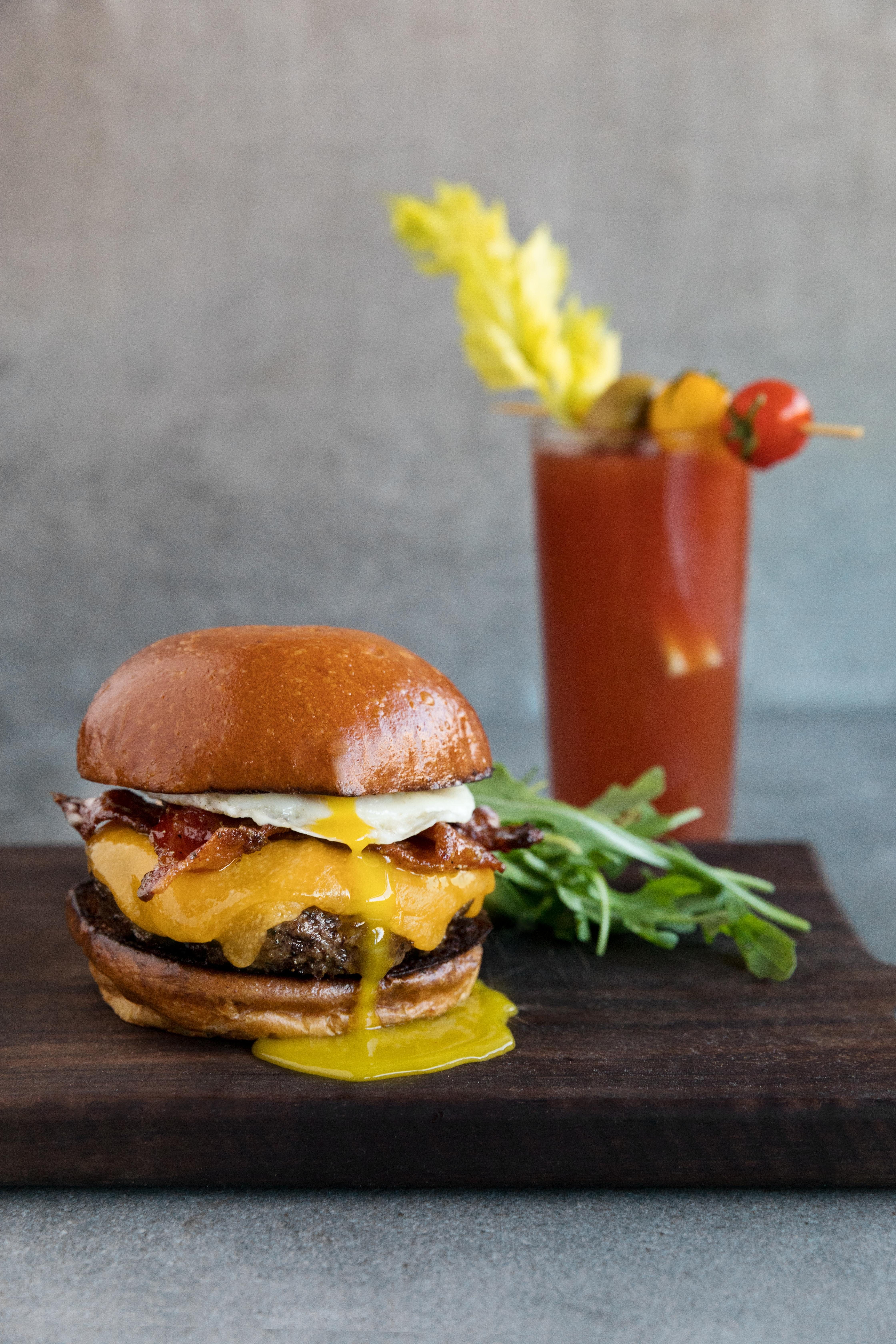 Head to North Bethesda's bustling Pike & Rose development for a brunch burger from City Perch ($19.99). The beef is topped with candied bacon, sharp cheddar, and a fried egg. (Image: Courtesy City Perch)
