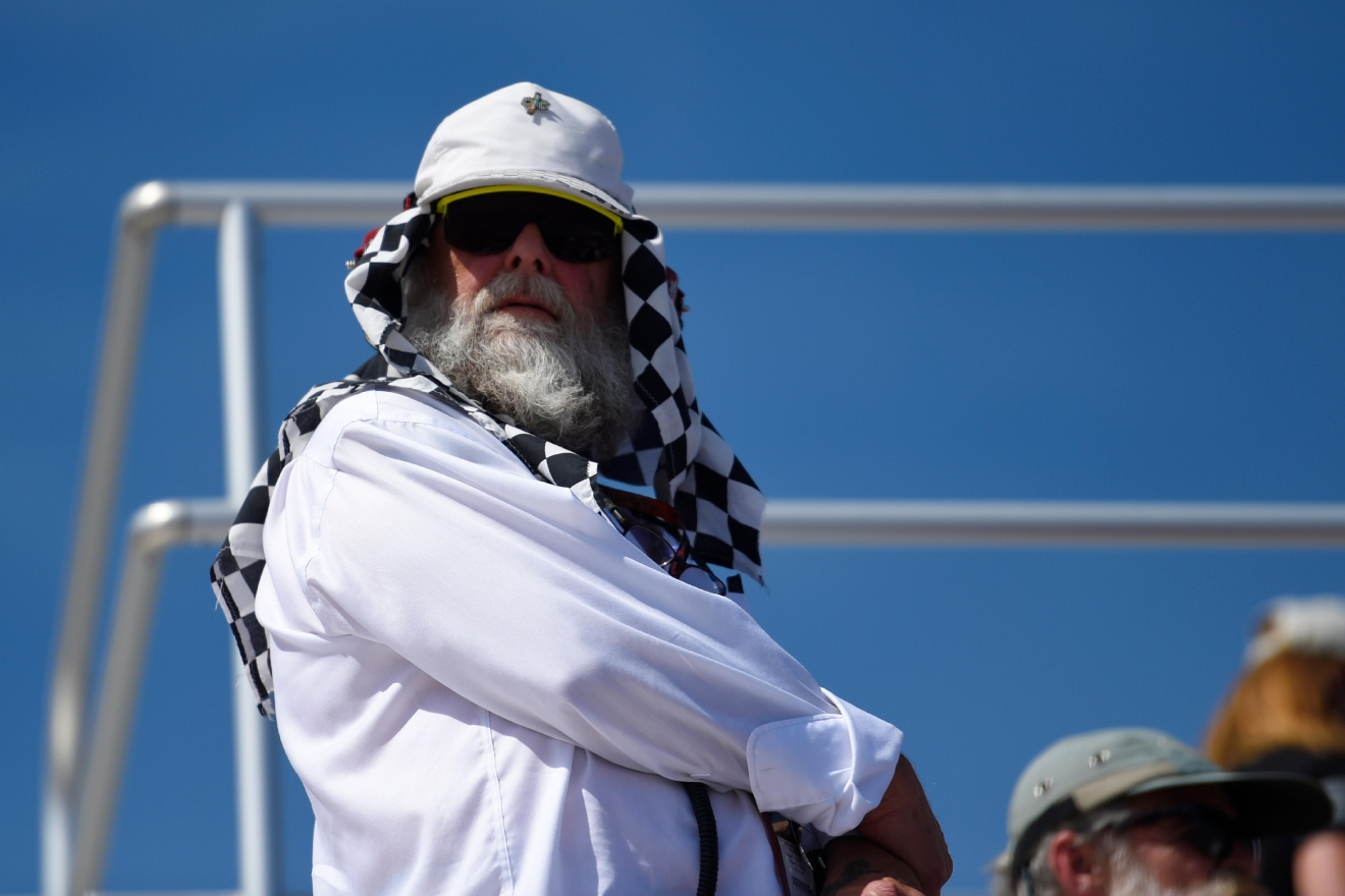 A race fan covers his head with checkered material during the Monster Energy NASCAR Cup Series Kobalt 400 Sunday, March 12, 2017, at the Las Vegas Motor Speedway. (Sam Morris/Las Vegas News Bureau)
