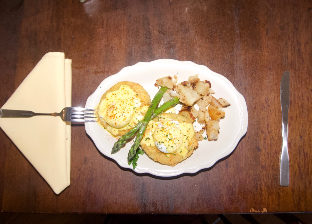 Southern eggs Benedict, with Canadian ham, fried green tomatoes, and asparagus / Image: Brian Planalp // Published: 6.18.18