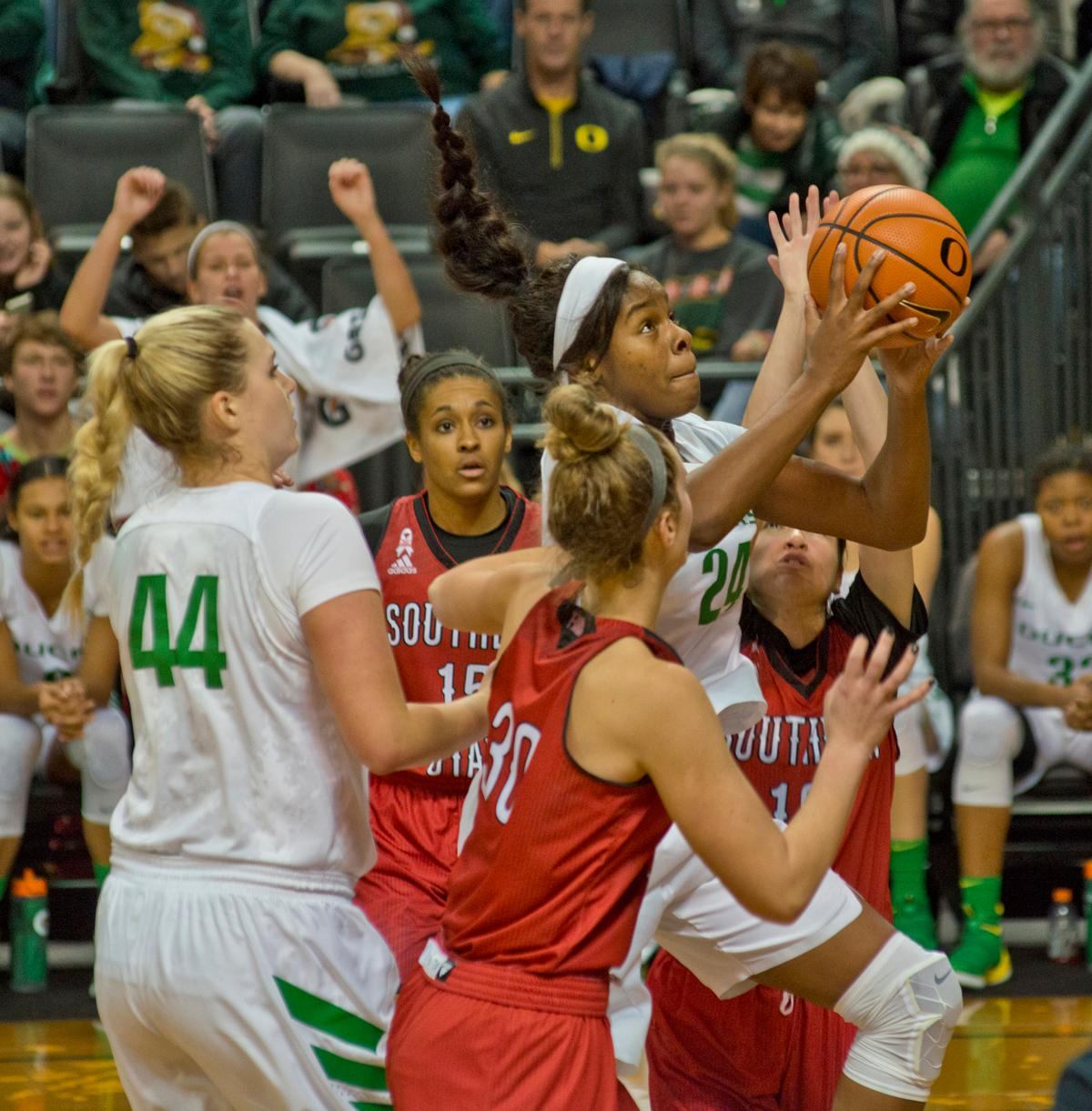 Oregon Ducks Ruthy Bebard (#24) goes up for a shot as the South Utah defense closes in. The University of Oregon Ducks women basketball team defeated the Southern Utah Thunderbirds 98-38 in Matthew Knight Arena Saturday afternoon. The Ducks had four players in double-digits: Ruthy Hebard with 13; Mallory McGwire with 10; Lexi Bando with 17 which included four three-pointers; and Sabrina Ionescu with 16 points. The Ducks overwhelmed the Thunderbirds, shooting 50% in field goals to South Utah's 26.8%, 53.8% in three-pointers to 12.5%, and 85.7% in free throws to 50%. The Ducks, with an overall record of 8-1, and coming into this game ranked 9th, will play their next home game against Ole Miss on December 17. Photo by Dan Morrison, Oregon News Lab