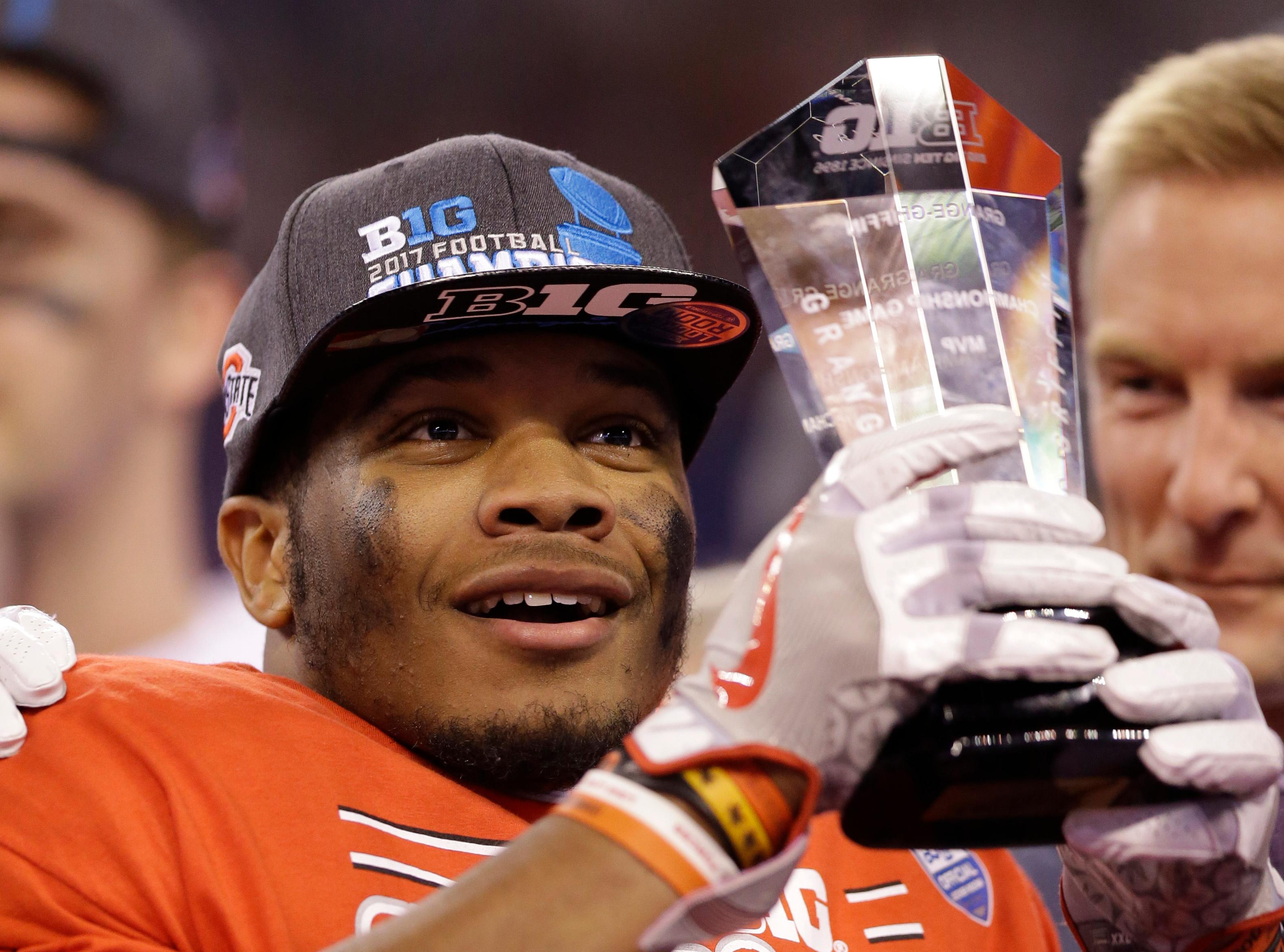 Ohio State's J.K. Dobbins holds the MVP trophy following the team's Big Ten championship NCAA college football game against Wisconsin, early Sunday, Dec. 3, 2017, in Indianapolis. Ohio State won 27-21. (AP Photo/AJ Mast)