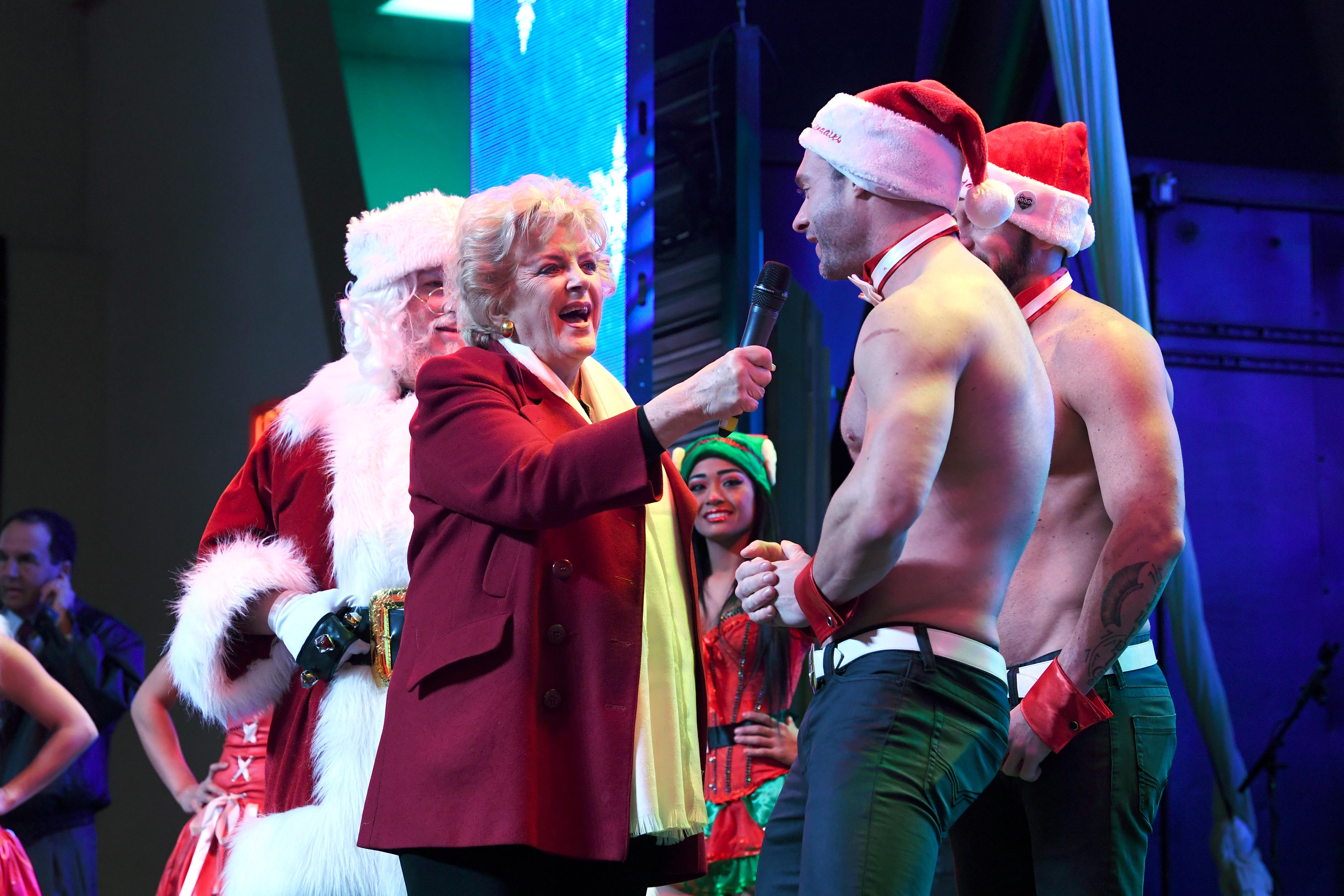 Las Vegas Mayor Carolyn Goodman speaks with a Chippendale dancer during the annual lighting of a Christmas tree at the Fremont Street Experience Tuesday, December 4, 2018. CREDIT: Sam Morris/Las Vegas News Bureau