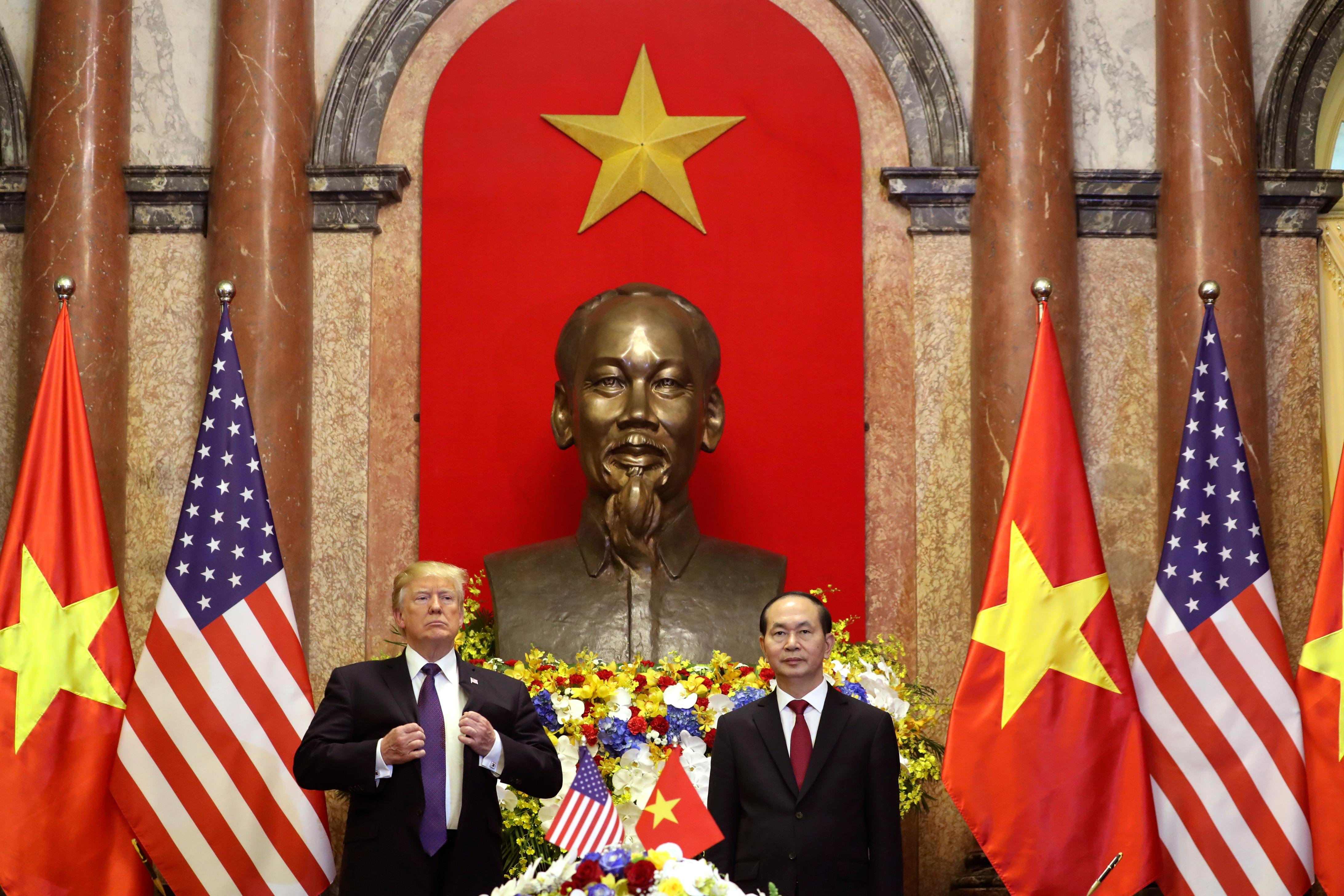 President Donald Trump, left, and Vietnamese President Tran Dai Quang pose for photographers at the Presidential Palace, Sunday, Nov. 12, 2017, in Hanoi, Vietnam. Trump is on a five country trip through Asia traveling to Japan, South Korea, China, Vietnam and the Philippines. (AP Photo/Andrew Harnik)