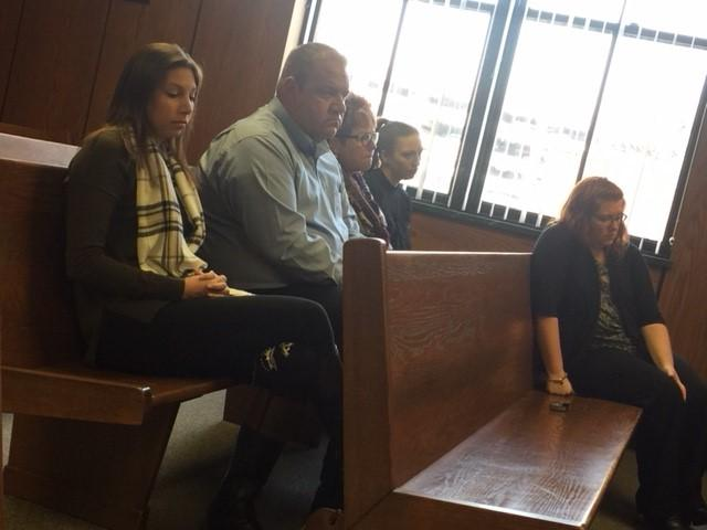 Ed Switalski's family listens to the proceedings in Kalamazoo County Circuit Court on Thursday, Dec. 14, 2017, as Brendon Clevenger enters a plea in the crash that killed the Comstock fire chief in June. (WWMT/Jessica Wheeler)<p></p>