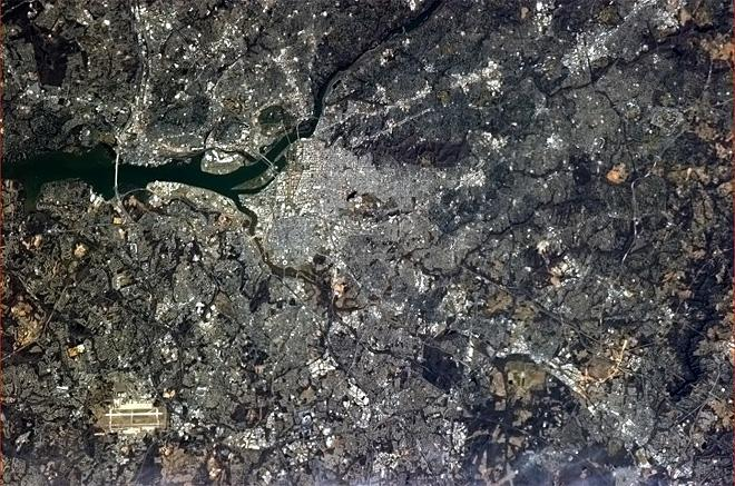 Washington, DC, waiting for the green of Spring. Andrews Air Force Base visible at lower l (Photo & Caption: Chris Hadfield/NASA) eft.