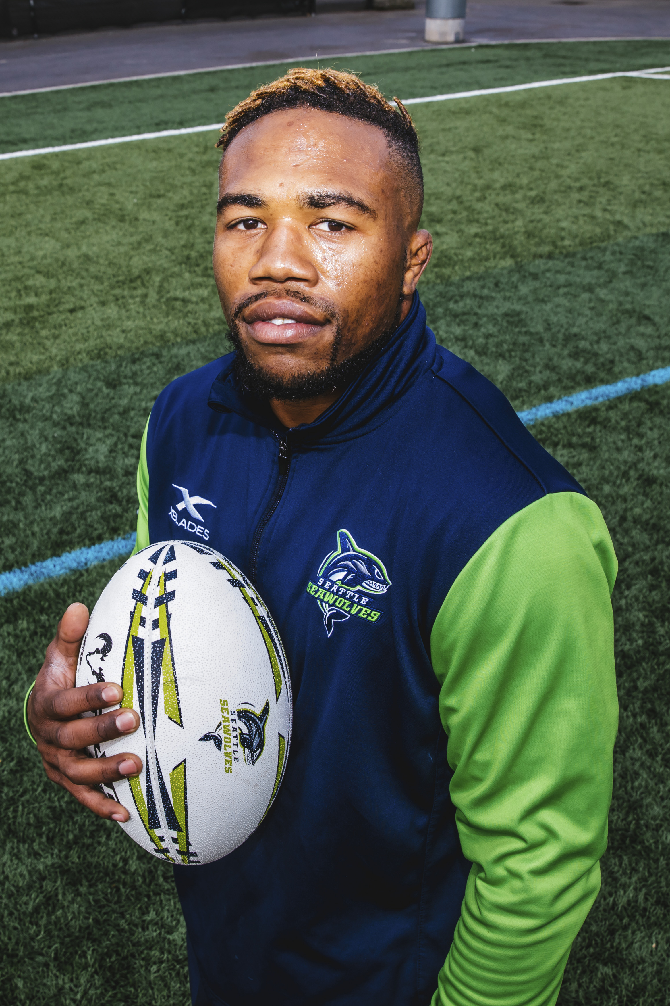 This handsome fella is Dion! Dion is 25 and is originally from Chicago Heights, Illinois. He plays Wing on the Seattle Seawolves and his favorite snack is cinnamon rolls. (Image: Sunita Martini / Seattle Refined).