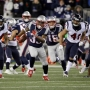 Lewis scores 3 TDS, Pats advance to AFC title game 34-16