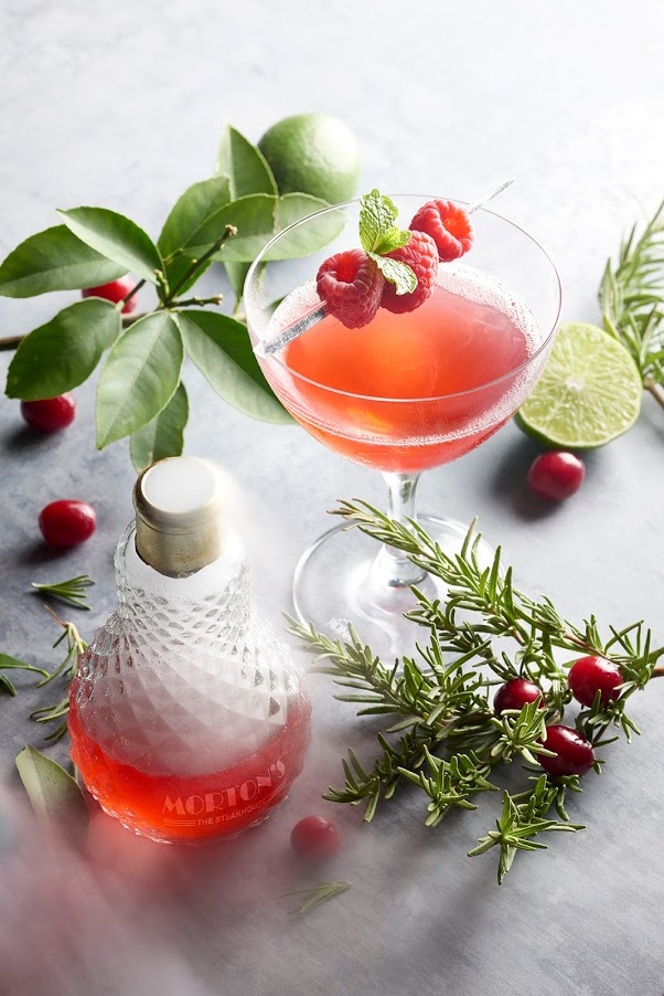 "Accompany your meal at Morton's with a ""Holiday Bliss"" cocktail, made with Grey Goose vodka, Passoa passion fruit liqueur, cranberry juice, lemon juice and Prosecco.{ }(Image: Courtesy Morton's)"
