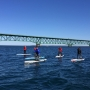 Eighth graders cross Straits of Mackinac on paddle boards for a good cause