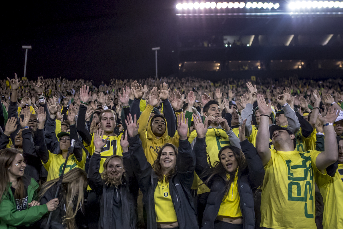 "The Oregon student section sings and sances along during ""Shout"" following the third quarter. The Washington State Cougars defeated the Oregon Ducks 33 to 10 on Saturday, October 7, 2017. Saturday's game was the first home loss for the Ducks under new head coach Willie Taggart. Photo by Ben Lonergan, Oregon News Lab"